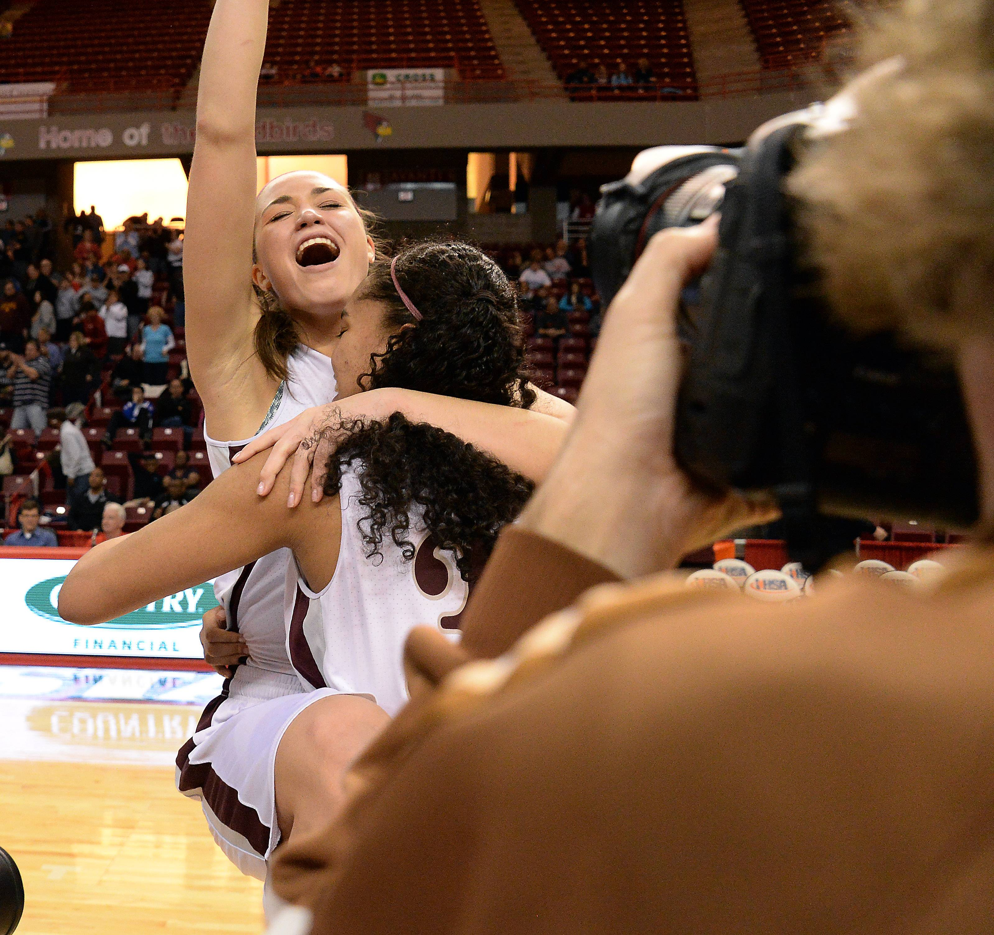 Montini's Kelsey Bogdan and Rainey Kuykendall celebrate their victory over Joliet Catholic in the Class 3A championship game in Normal on Saturday.