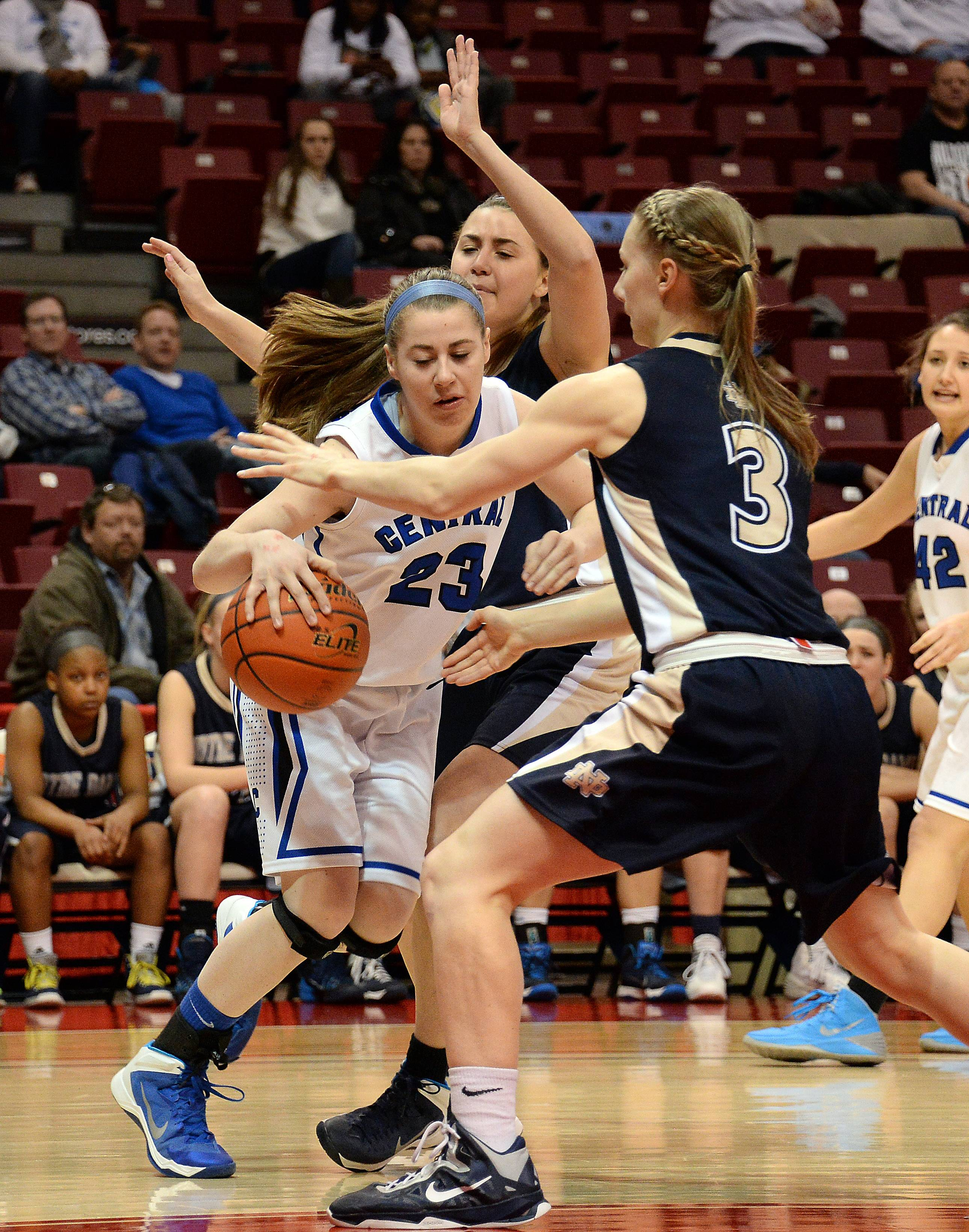 Burlington Central's Aly DeTamble is stopped by Quincy Notre Dame's Kristen Gengenbacher in the first period of girls state basketball in the third place game in Normal on Saturday.