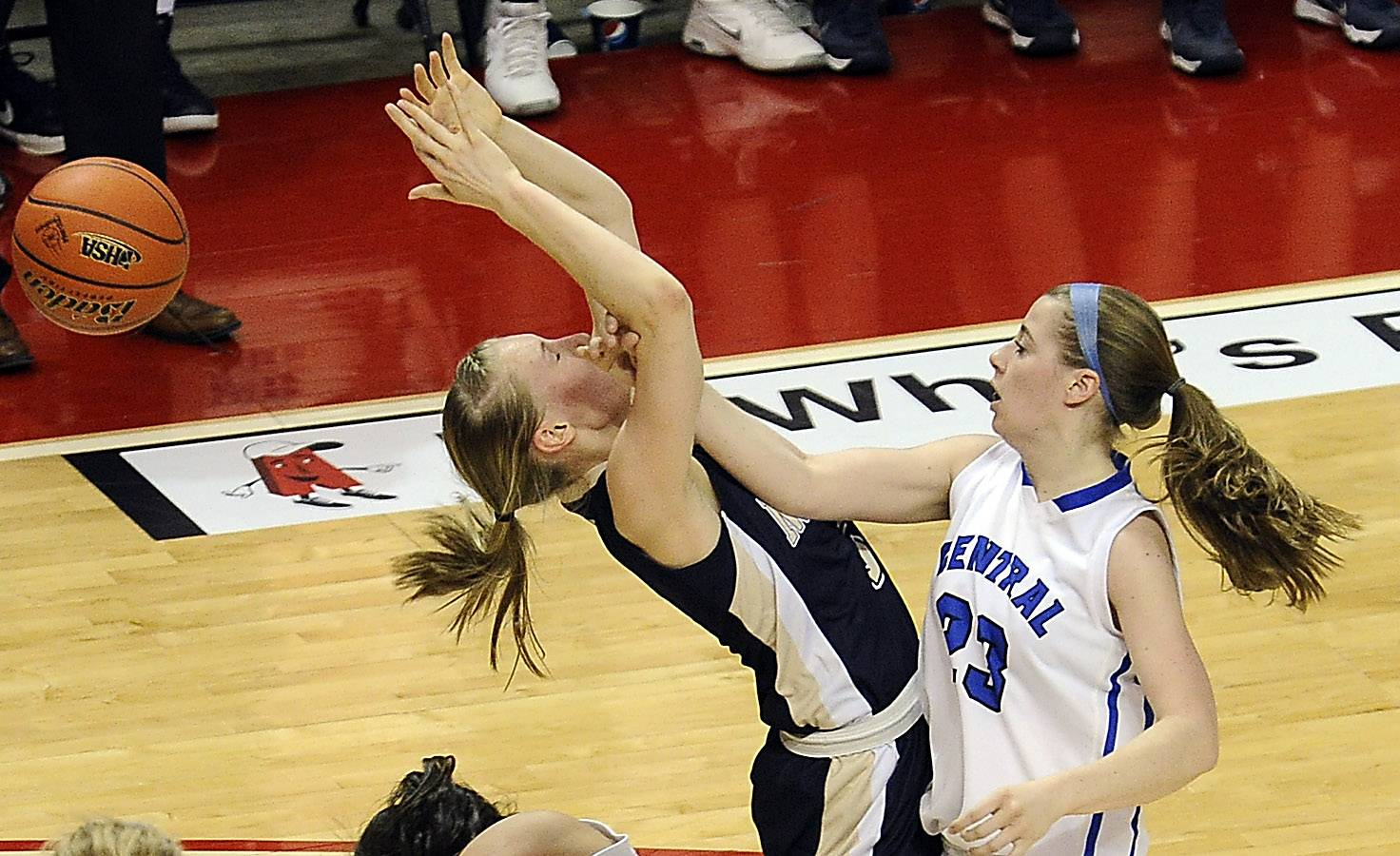 Burlington Central's Aly DeTamble delivers a shot to Quincy Notre Dame's Kristen Gengenbacher in the first period of girls state basketball in the third place game in Normal on Saturday.
