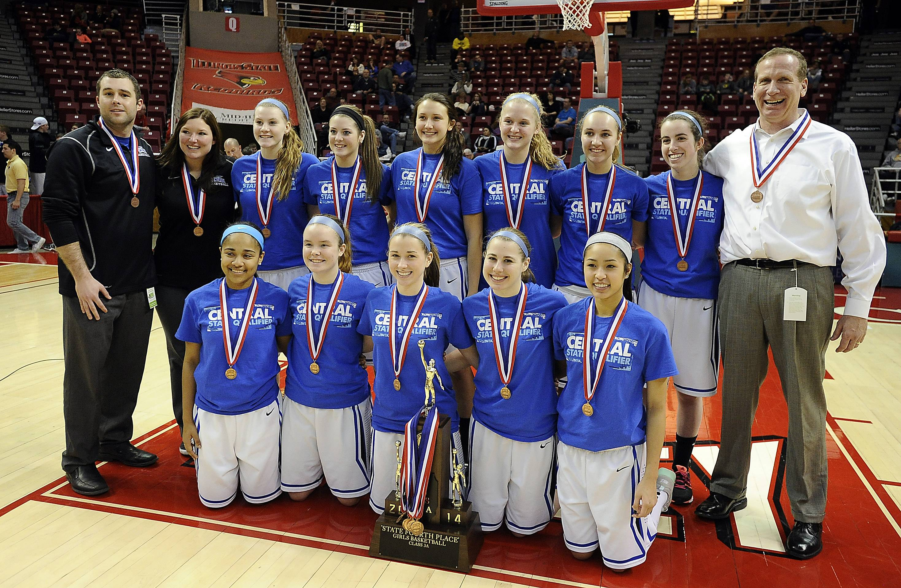 Burlington Central's players with their Class 3A fourth-place trophy Saturday at Redbird Arena in Normal.