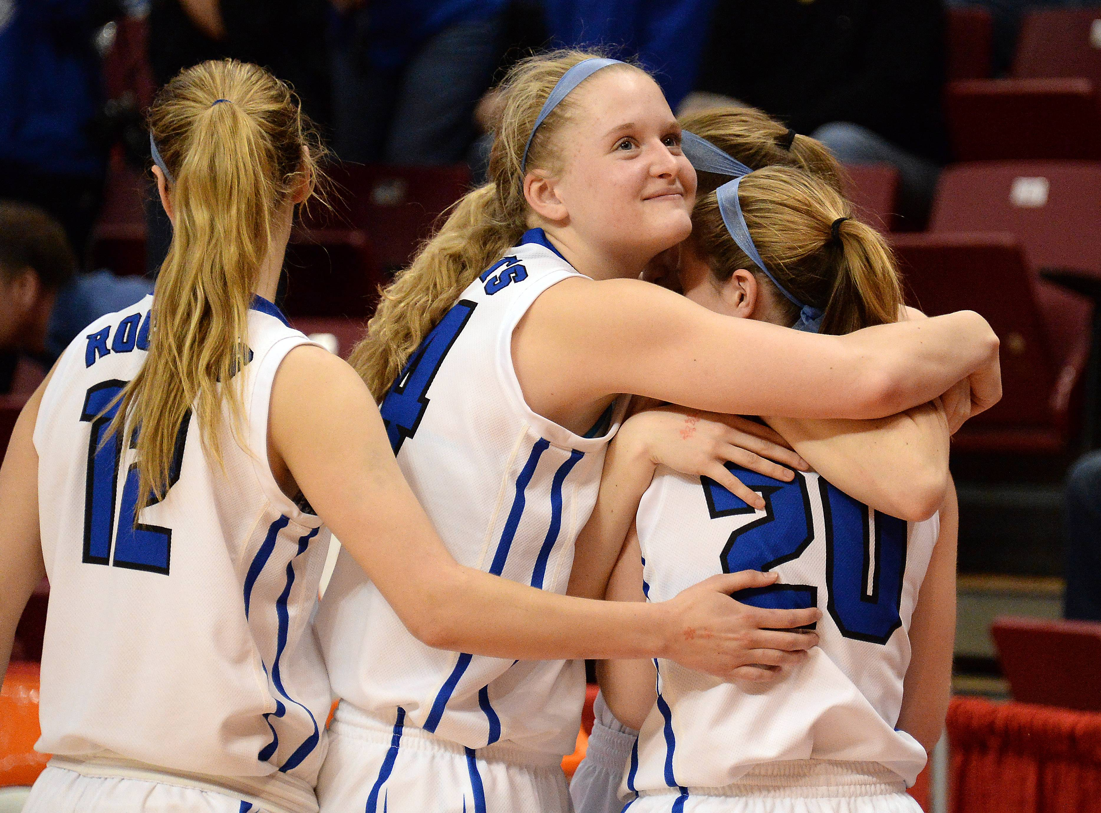 Burlington Central's Shelby Holt, Sam Pryor, Kayla Ross and Kathleen Ratzek all come together as their season comes to an end Saturday in Normal.