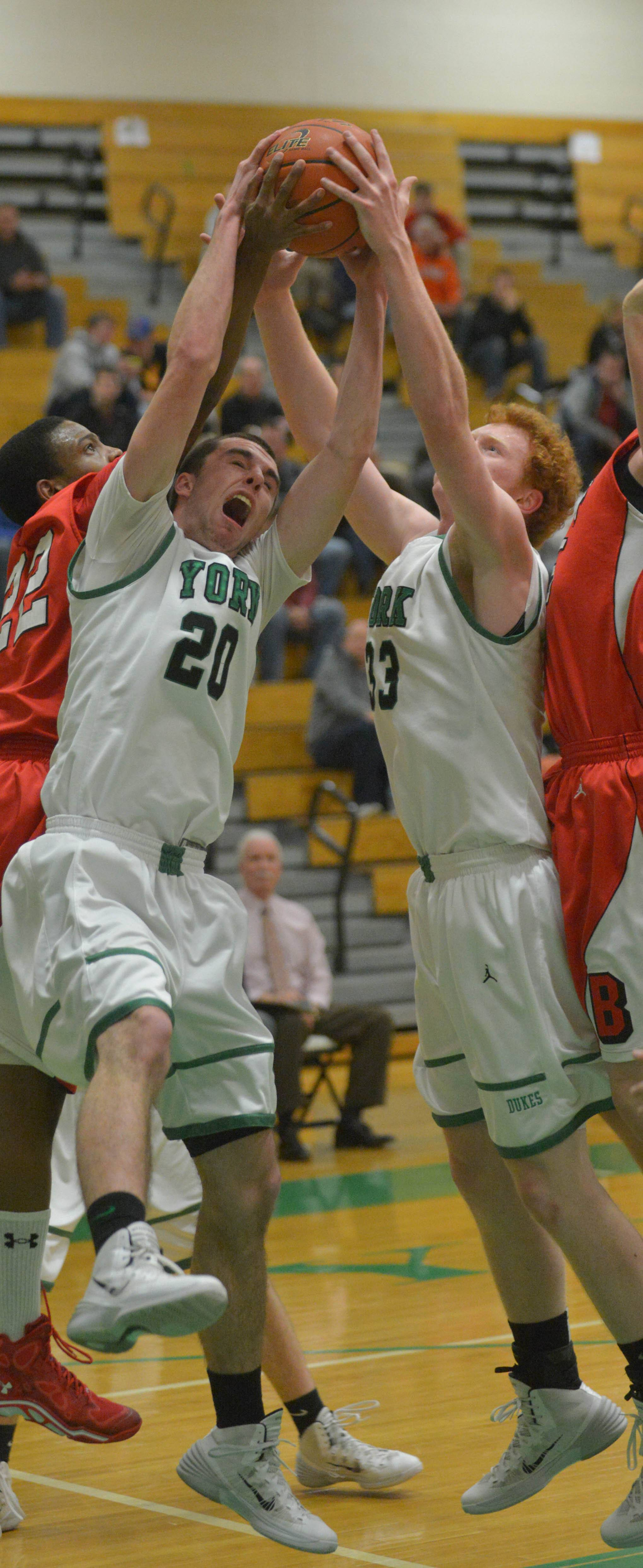 Charlie Rose and Frank Toohey of York pull down a rebound during Benet at York.