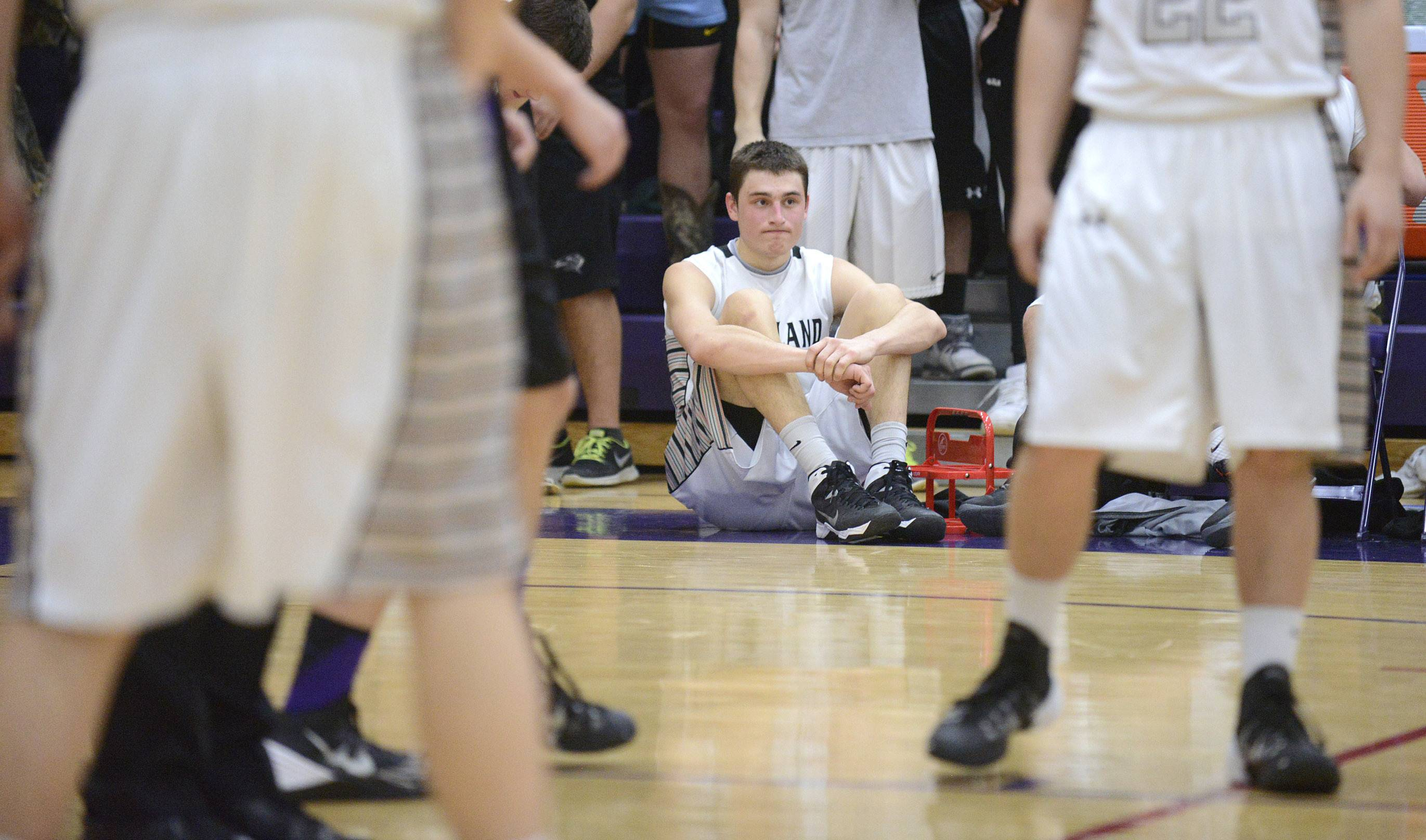 Kaneland's John Pruett sits at the end of the bench watching the final seconds of the Knights' Class 3A sectional loss to Rockford Lutheran at Hampshire HIgh School on Tuesday, March 11.