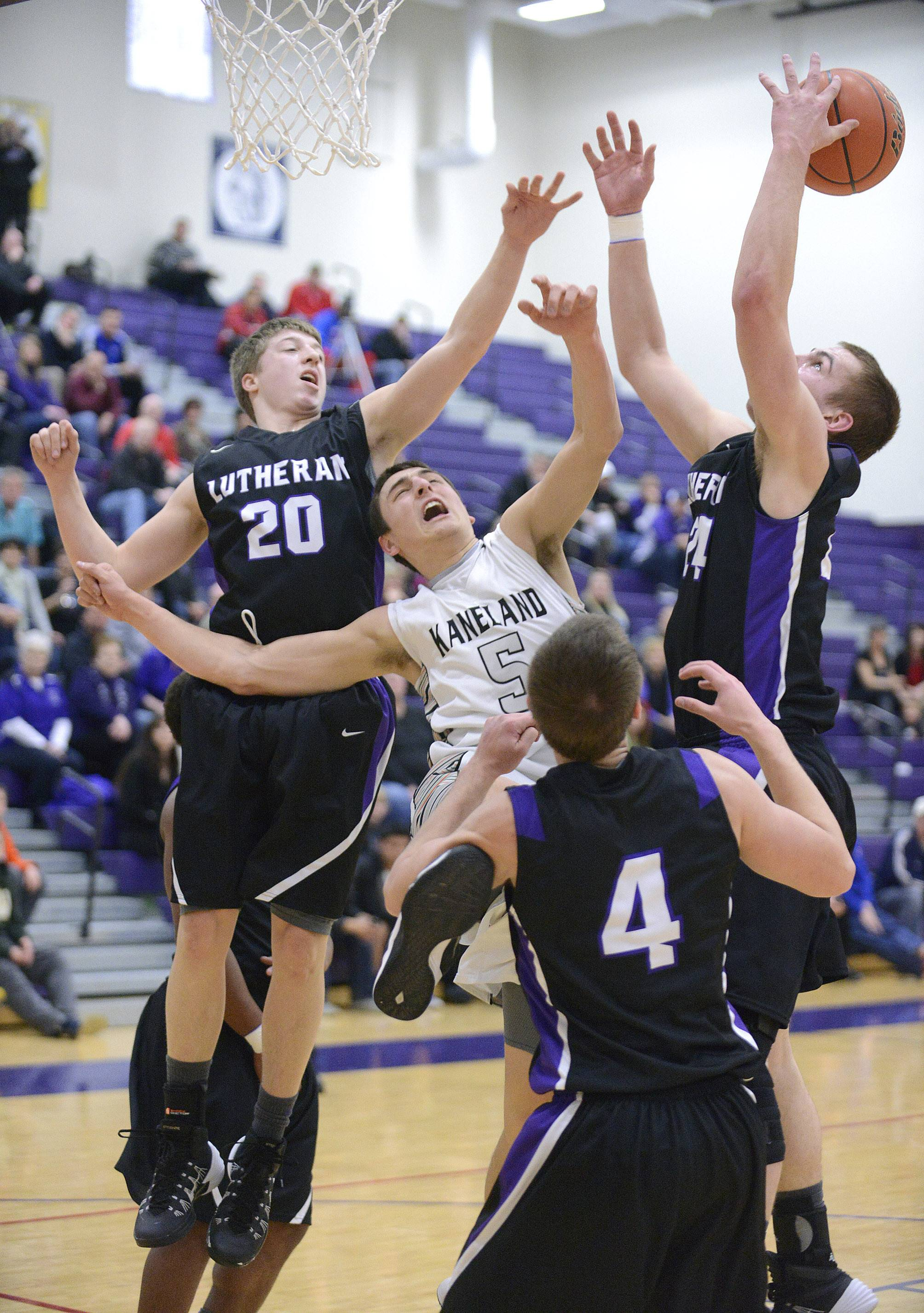 Kaneland's John Pruett is denied a shot by Rockford Lutheran's Joseph Kellen sending the ball over to Rockford Lutheran's Nate Wieting in the first quarter of the Class 3A sectional game at Hampshire HIgh School on Tuesday, March 11.