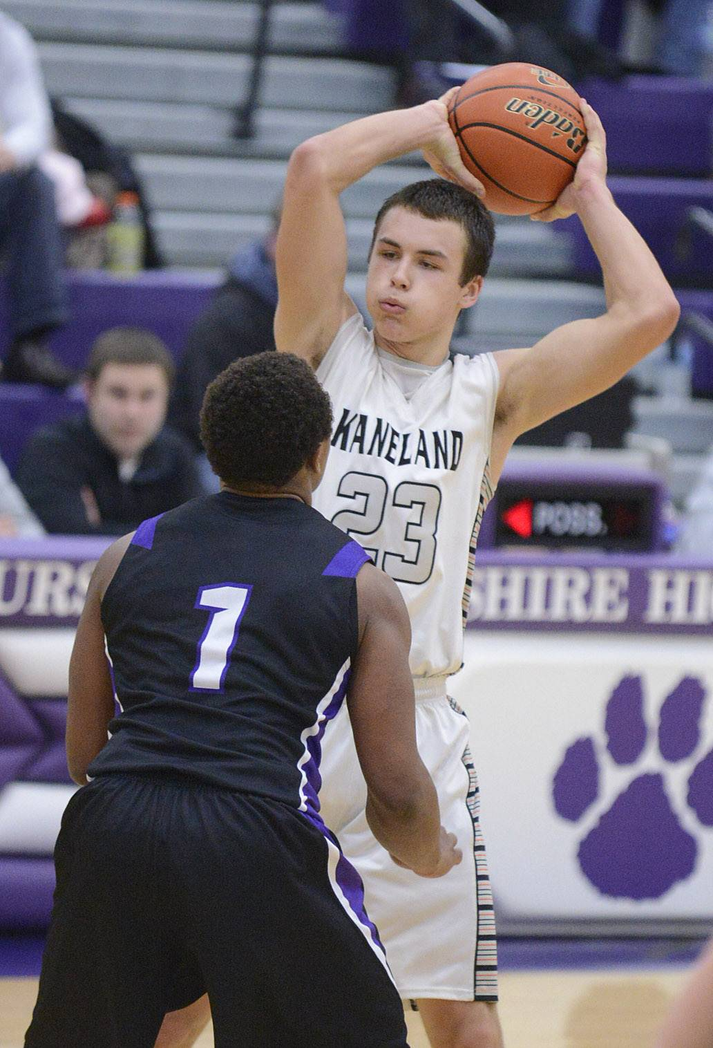 Kaneland's Tyler Carlson looks to pass over Rockford Lutheran's James Robinson in the third quarter of the Class 3A sectional game at Hampshire HIgh School on Tuesday, March 11.