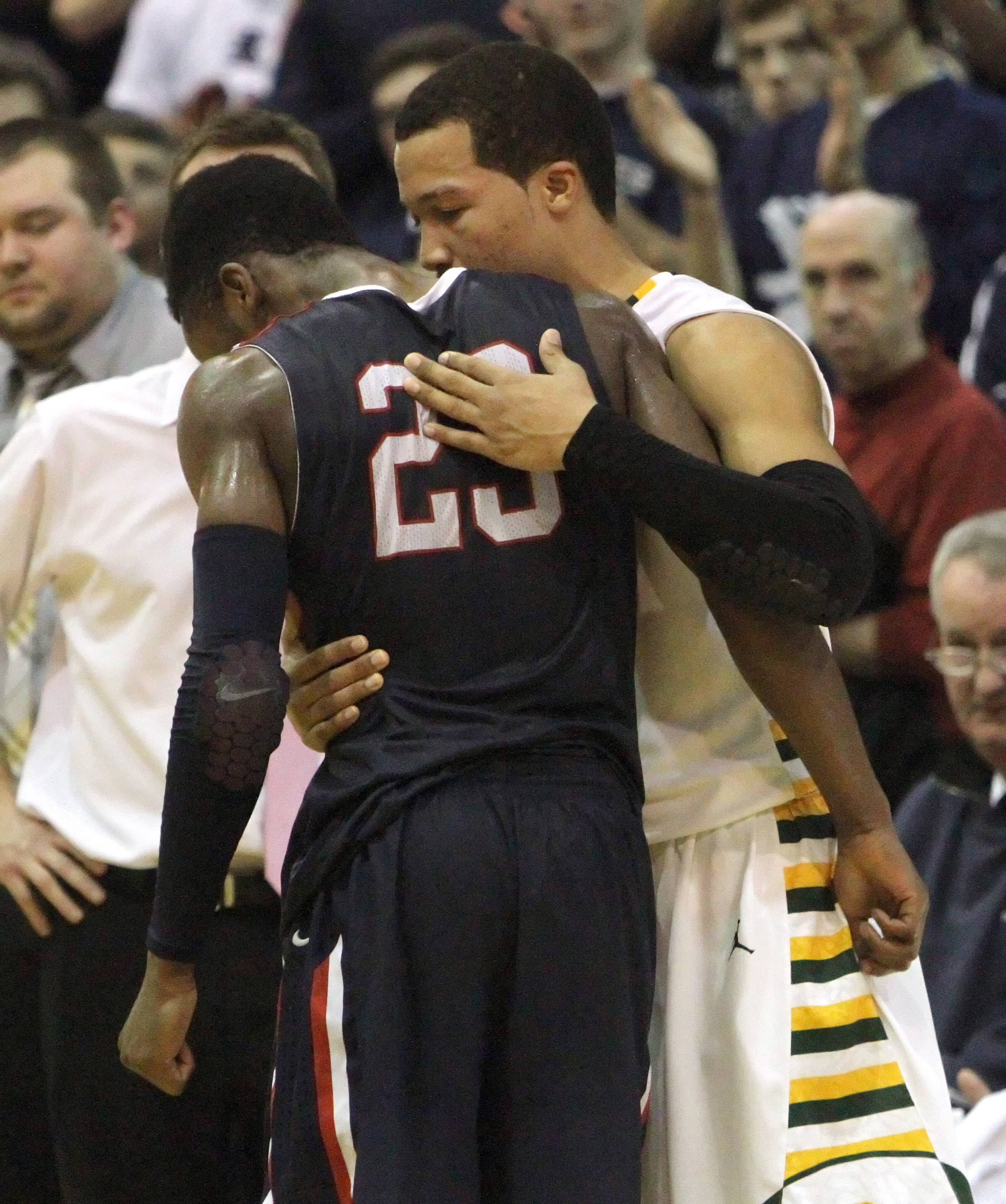 Stevenson's Jalen Brunson, right, consoles St. Viator's Ore Arogundade at game's end in Class 4A sectional semifinal play at Lake Zurich on Tuesday.