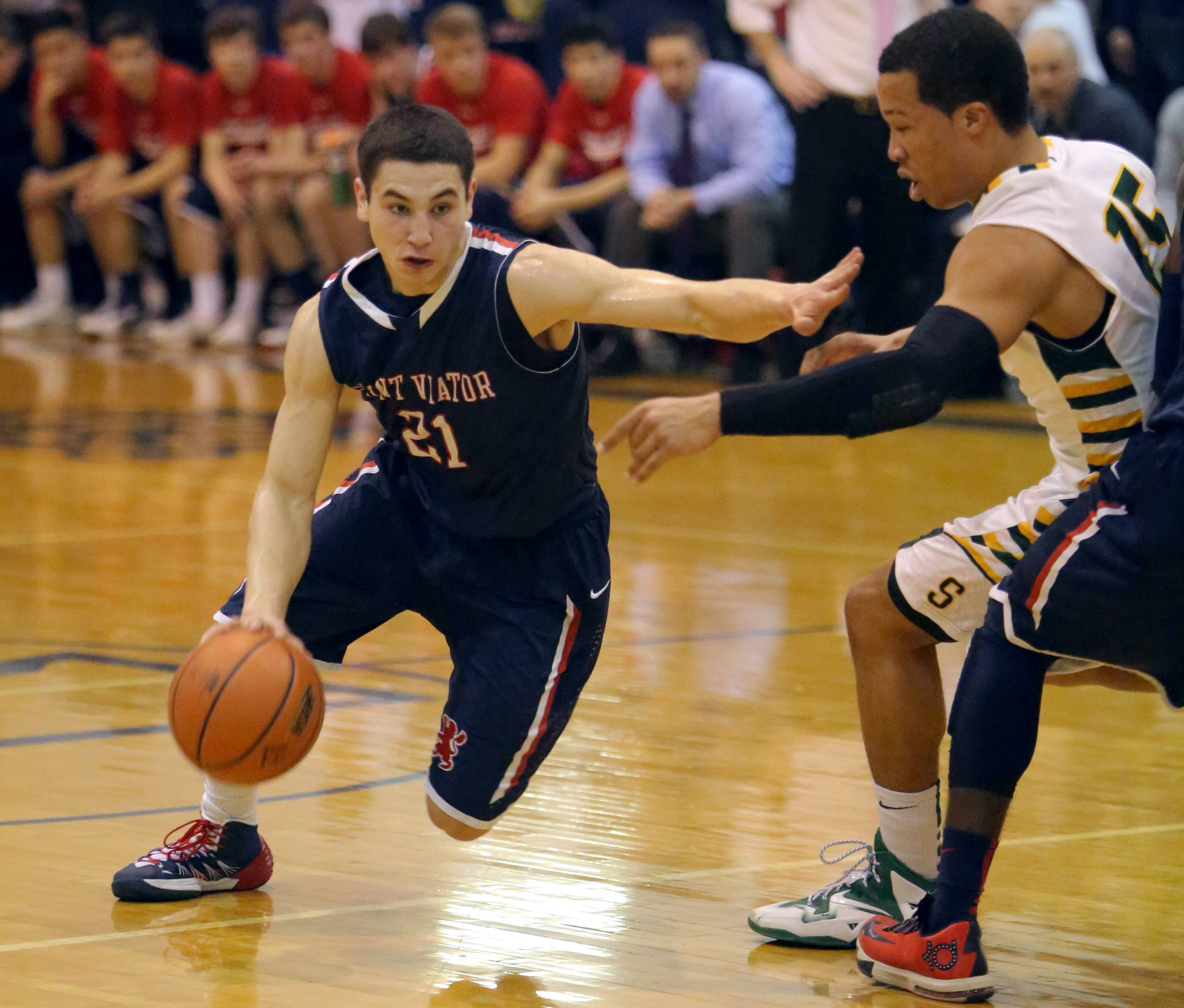 St. Viator's Mark Falotico, left, drives on Stevenson's Jalen Brunson during the Class 4A sectional semifinal at Lake Zurich on Tuesday.