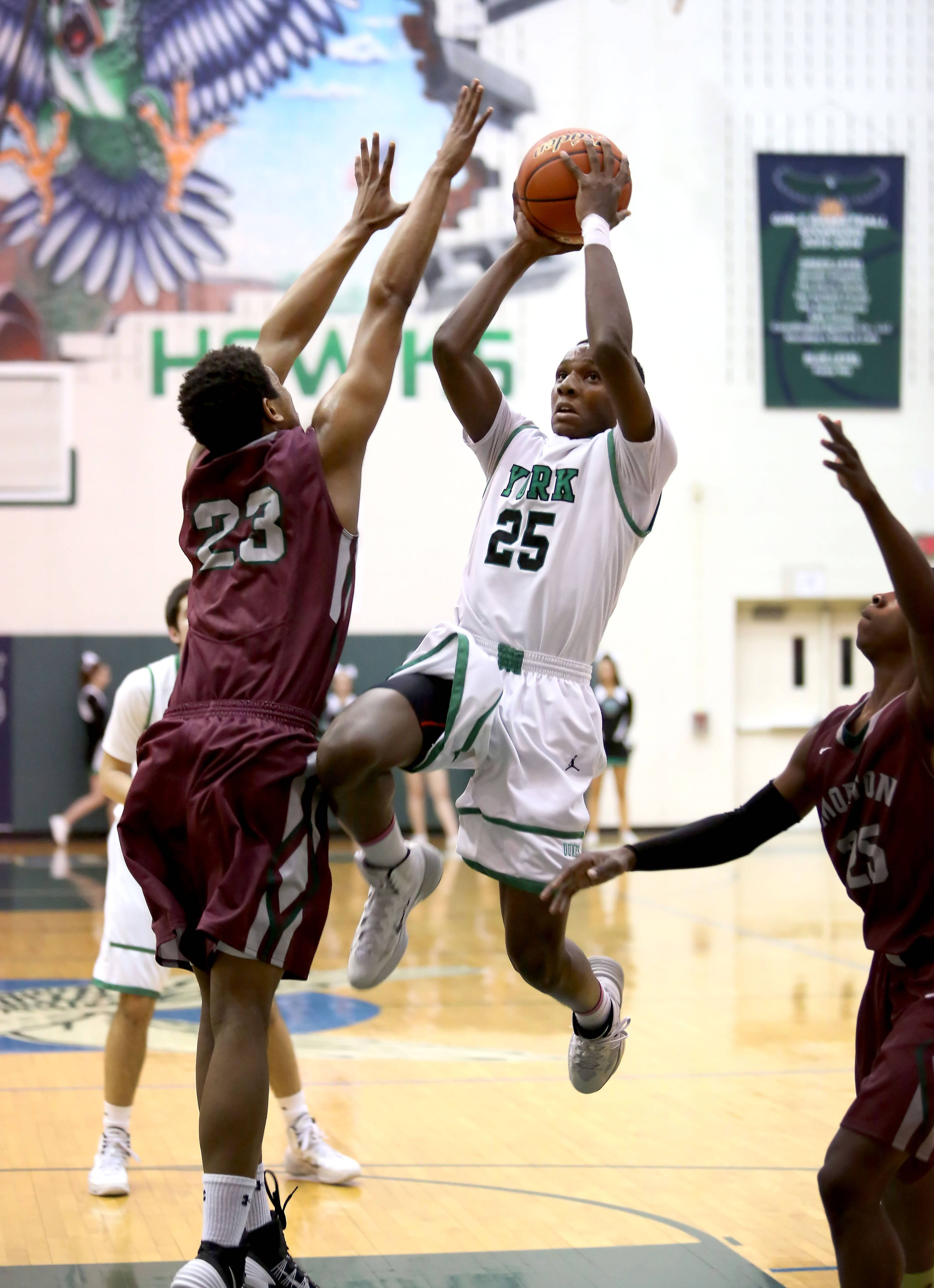 York's Stanley Roberts, center, goes up for a basket.