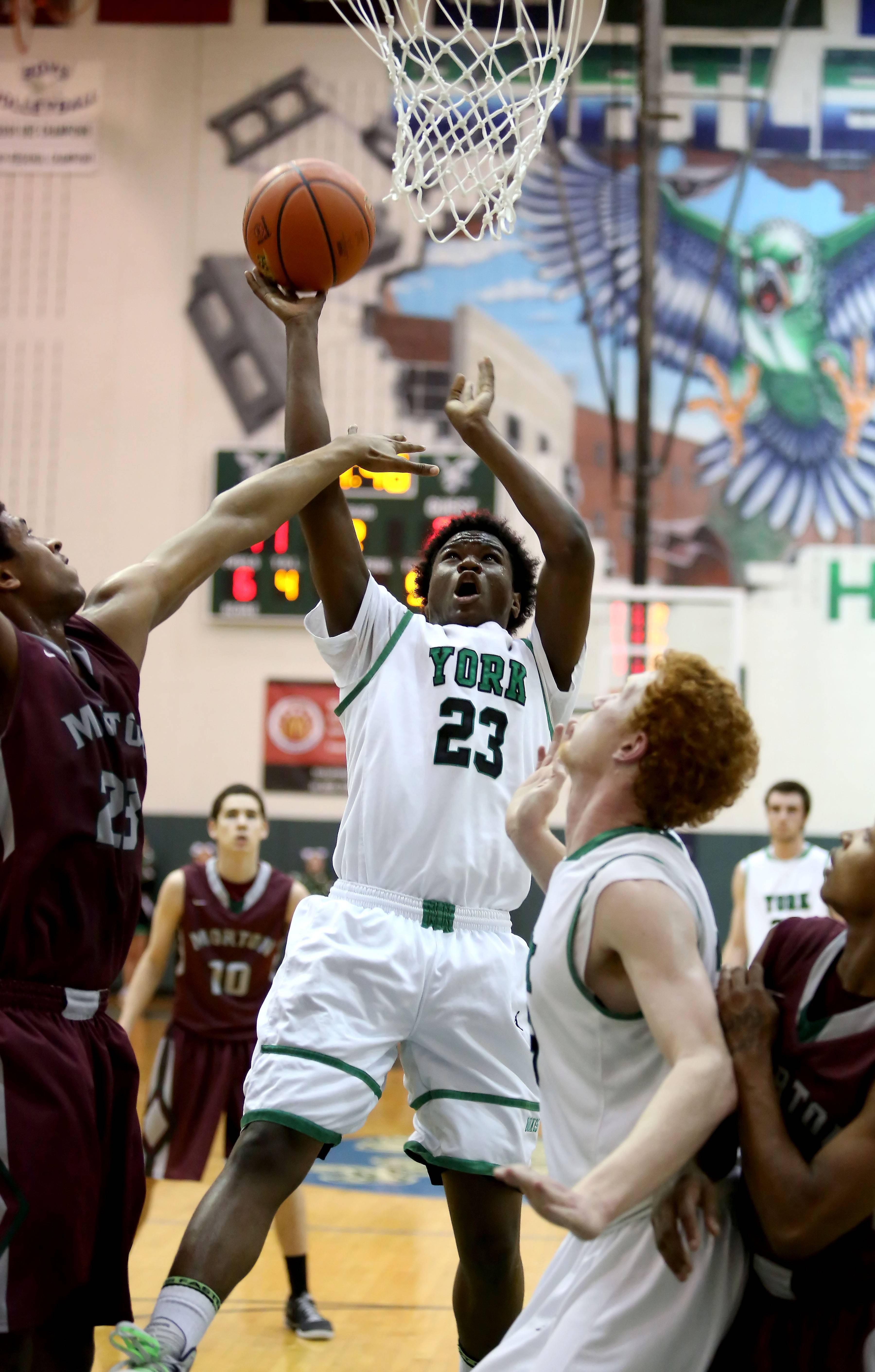 York's Jayvon Thomas goes up for a basket against Morton.