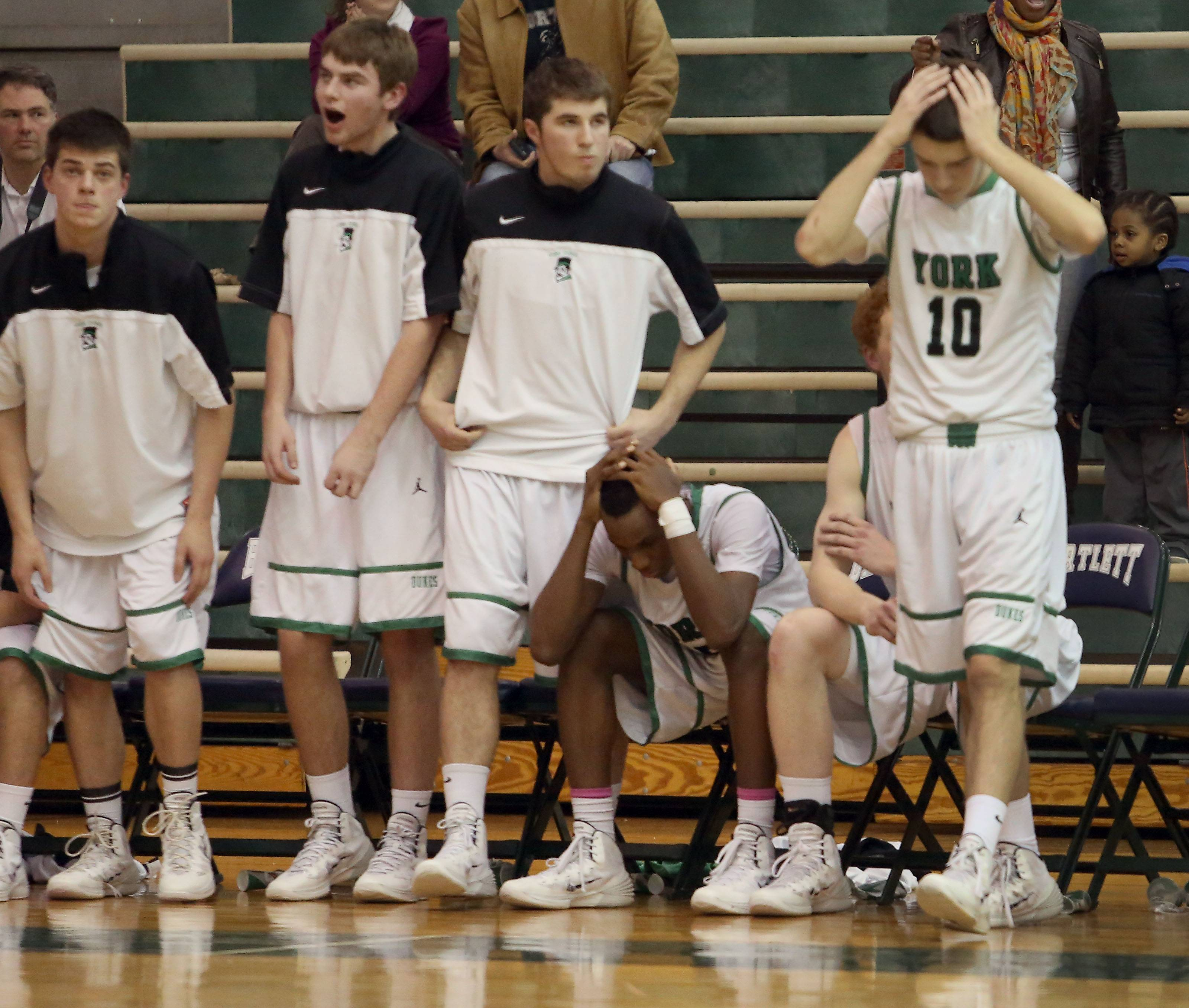 York players react as they lose to Morton in triple overtime.