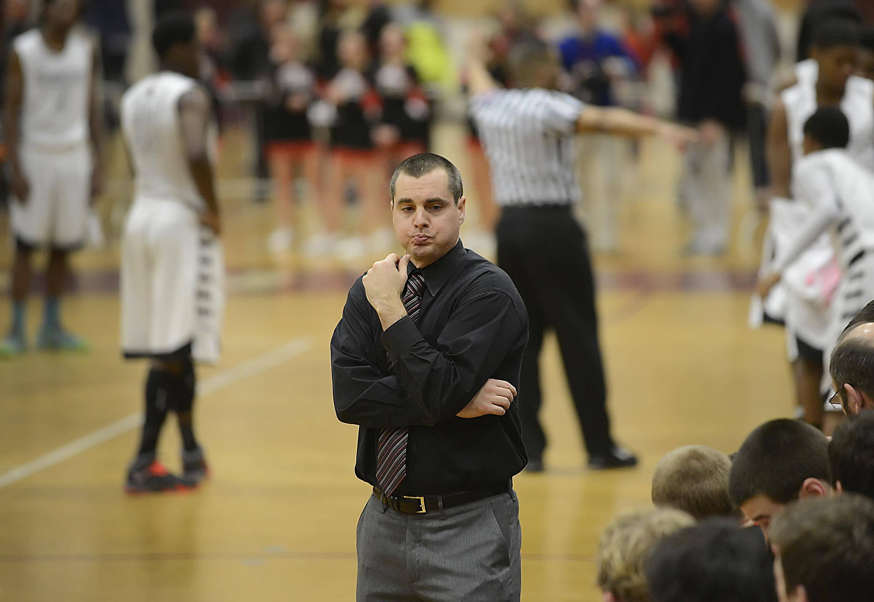 Huntley coach Marty Manning looks to his bench in the final two minutes of the Red Raiders' loss to Rockford Auburn.