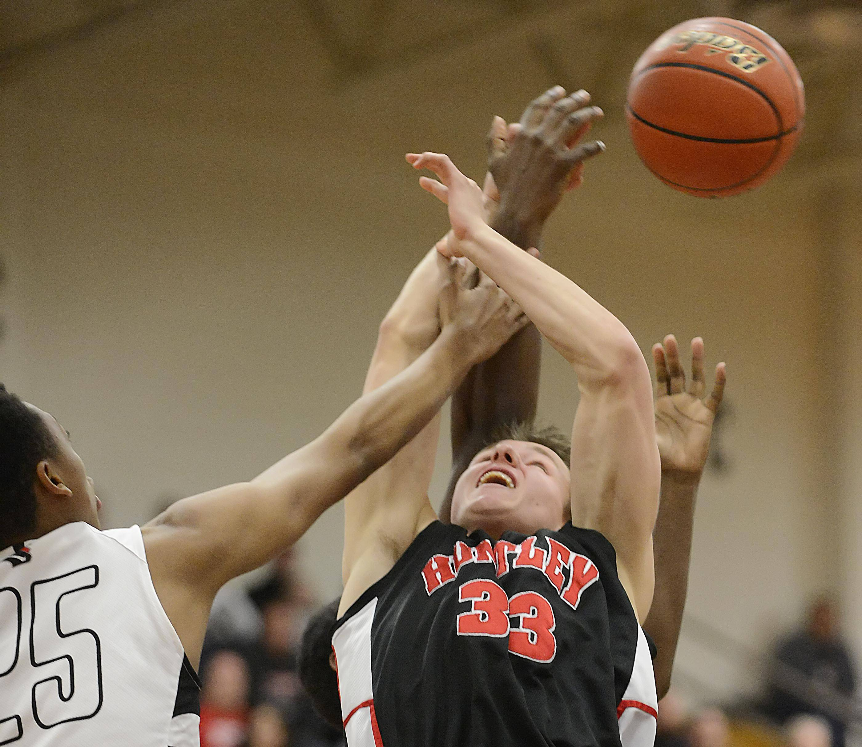 Huntley's Zach Gorney can't control a rebound against Rockford Auburn's defense in the Class 4A Elgin sectional semifinal Tuesday.