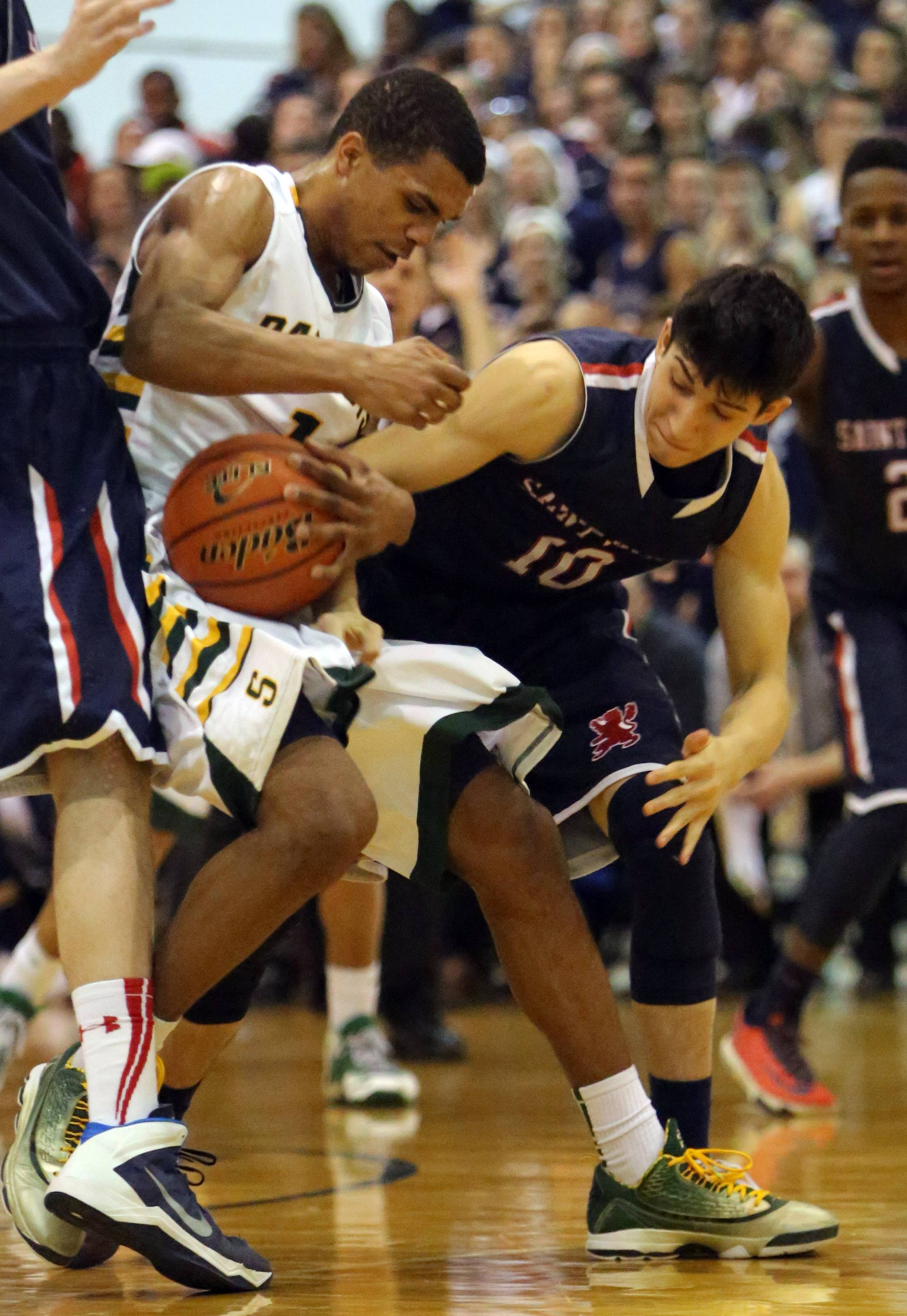 Stevenson's Connor Cashaw, left, and St. Viator's Robert Grant battle for a loose ball.
