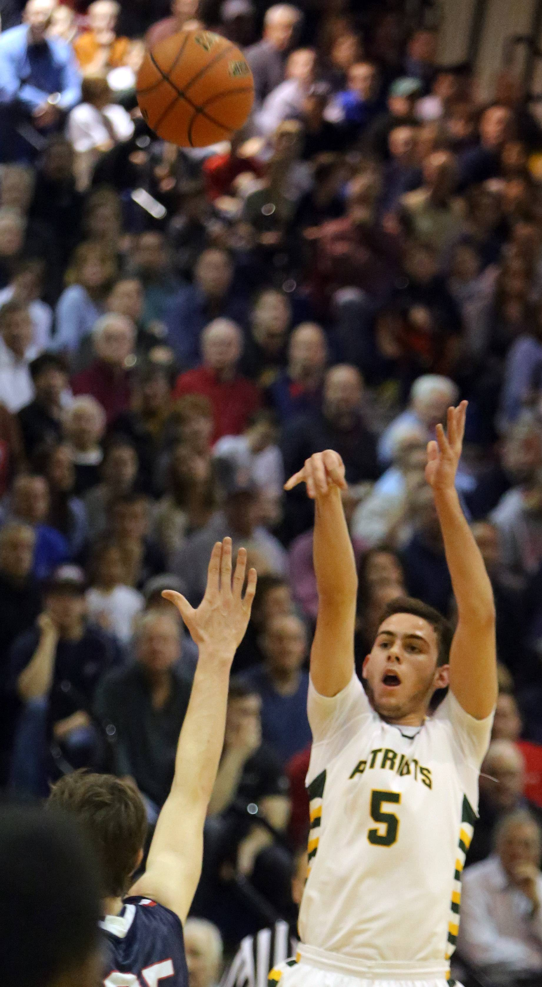 Stevenson's Parker Nichols, right, shoots a three-pointer over St. Viator's Tom Martin .