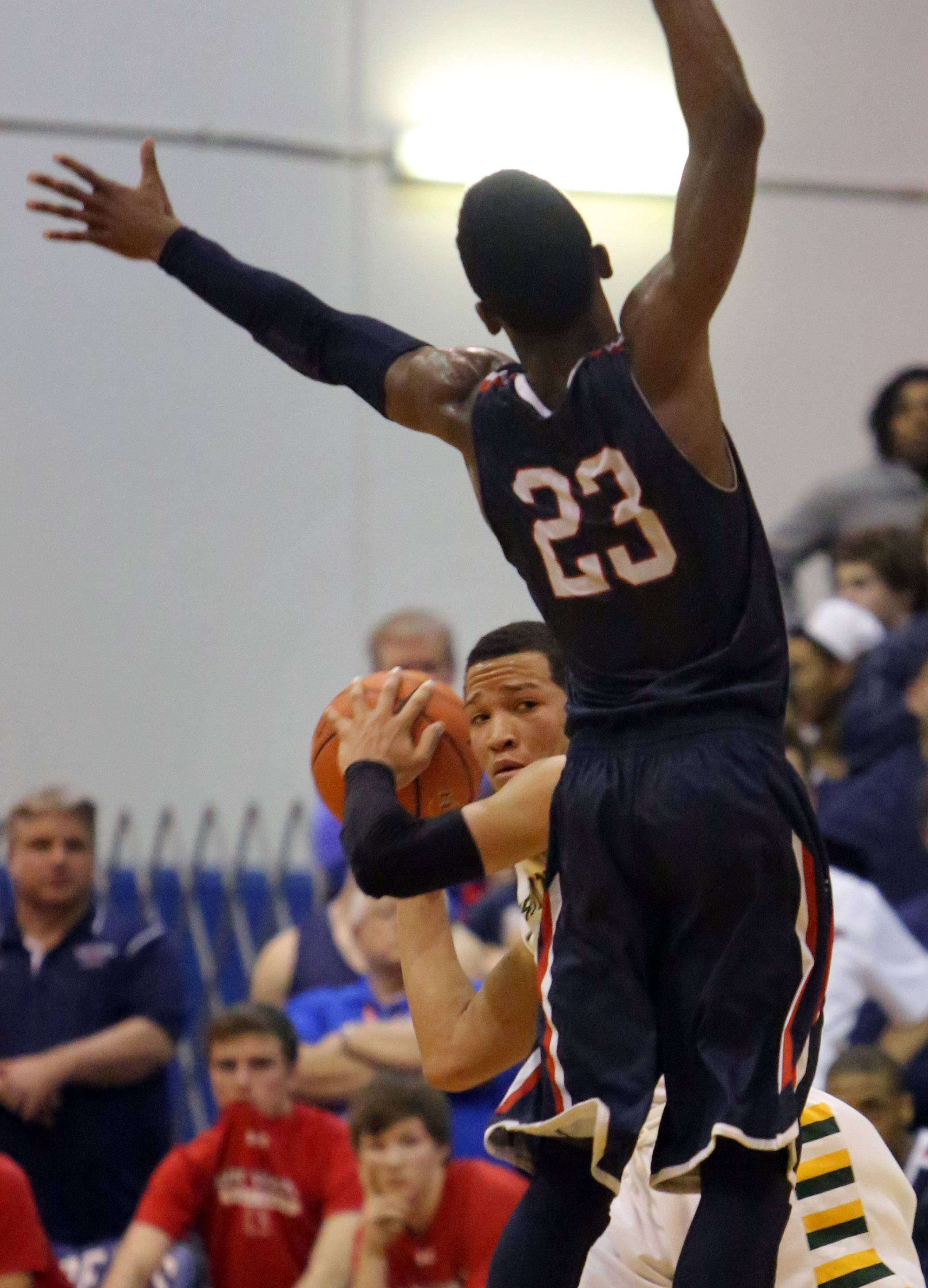 Stevenson's Jalen Brunson, left,  looks to pass over St. Viator's Ore Arogundade .