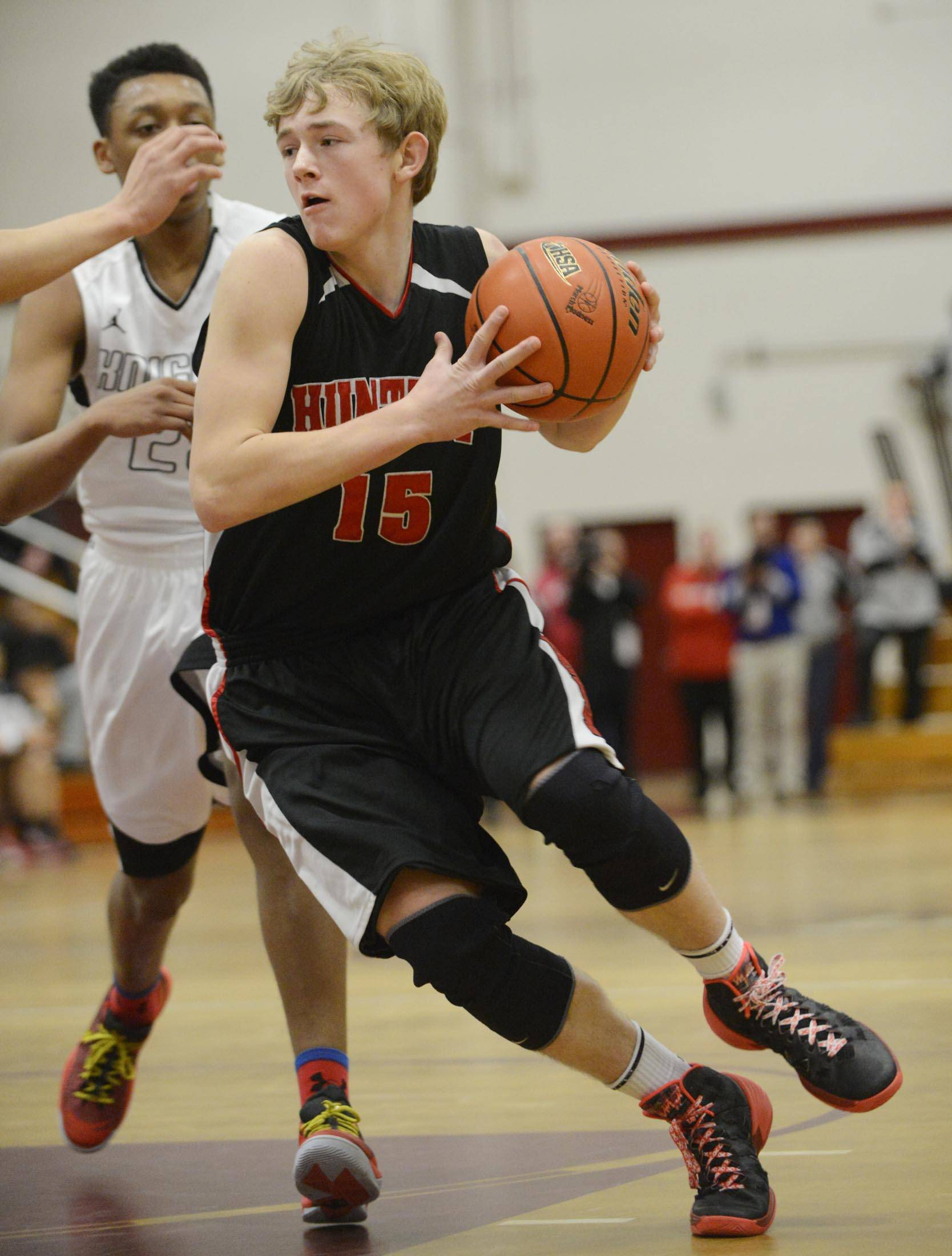 Images from the Huntley vs. Rockford Auburn boys sectional semifinal basketball game Tuesday, March 11, 2014 in Elgin.