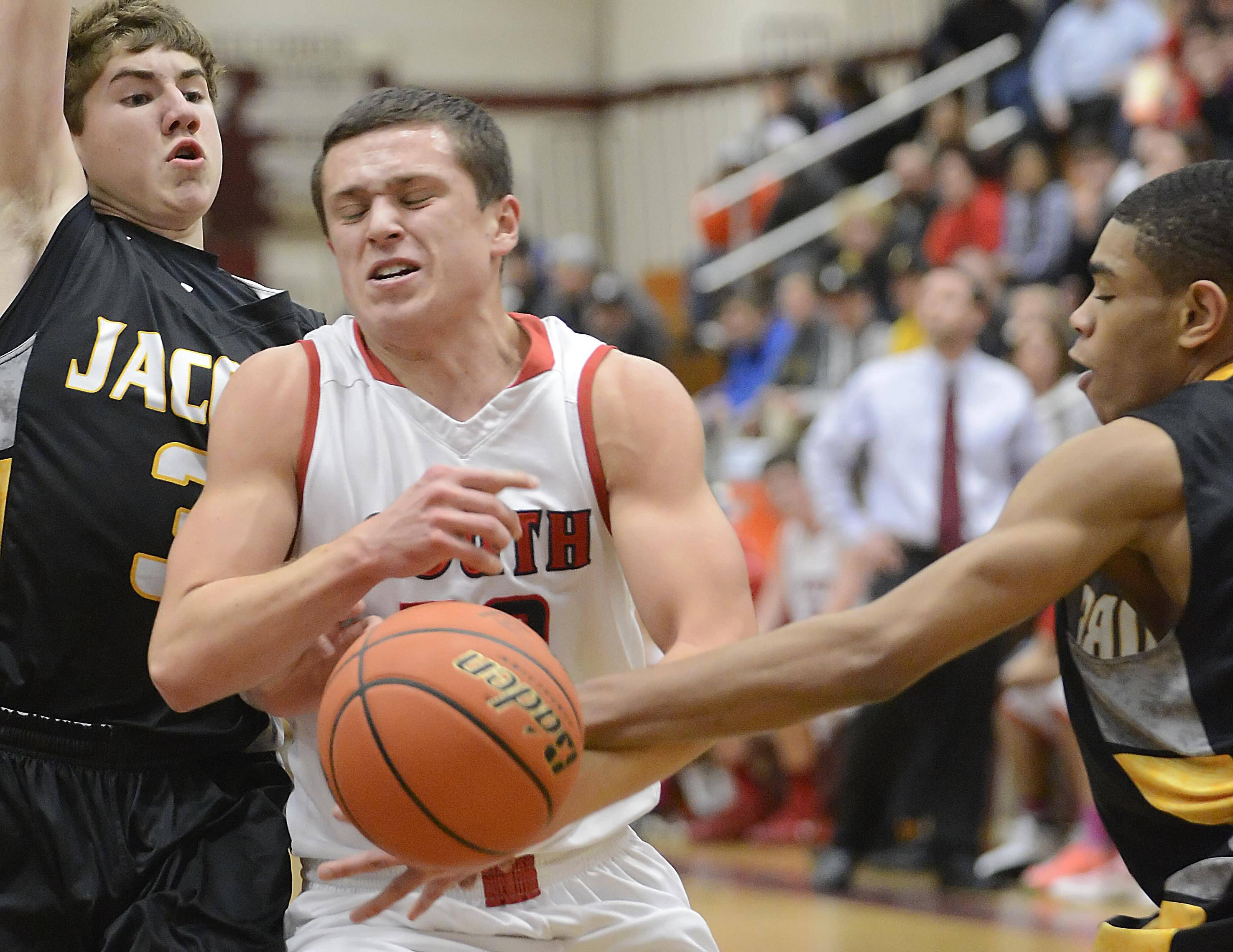 South Elgin's Matt McClure is fouled by Jacobs' Kenton Mack Wednesday in the Class 4A Elgin sectional semifinal.