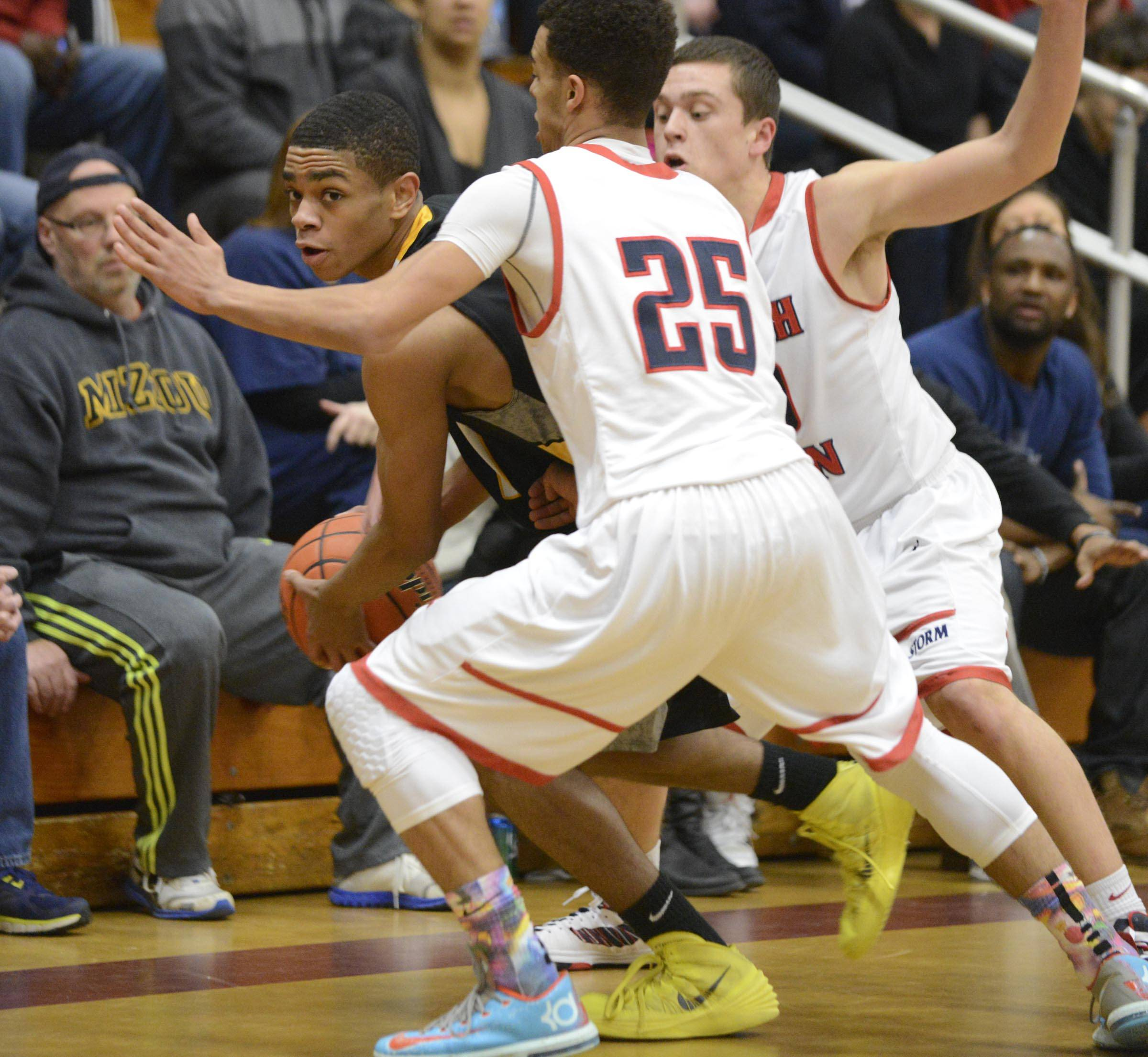 John Starks/jstarks@dailyherald.comSouth Elgin's Darius Wells and Matt McClure, right, double team Jacobs' Kenton Mack Wednesday in the Elgin 4A sectional semifinal.