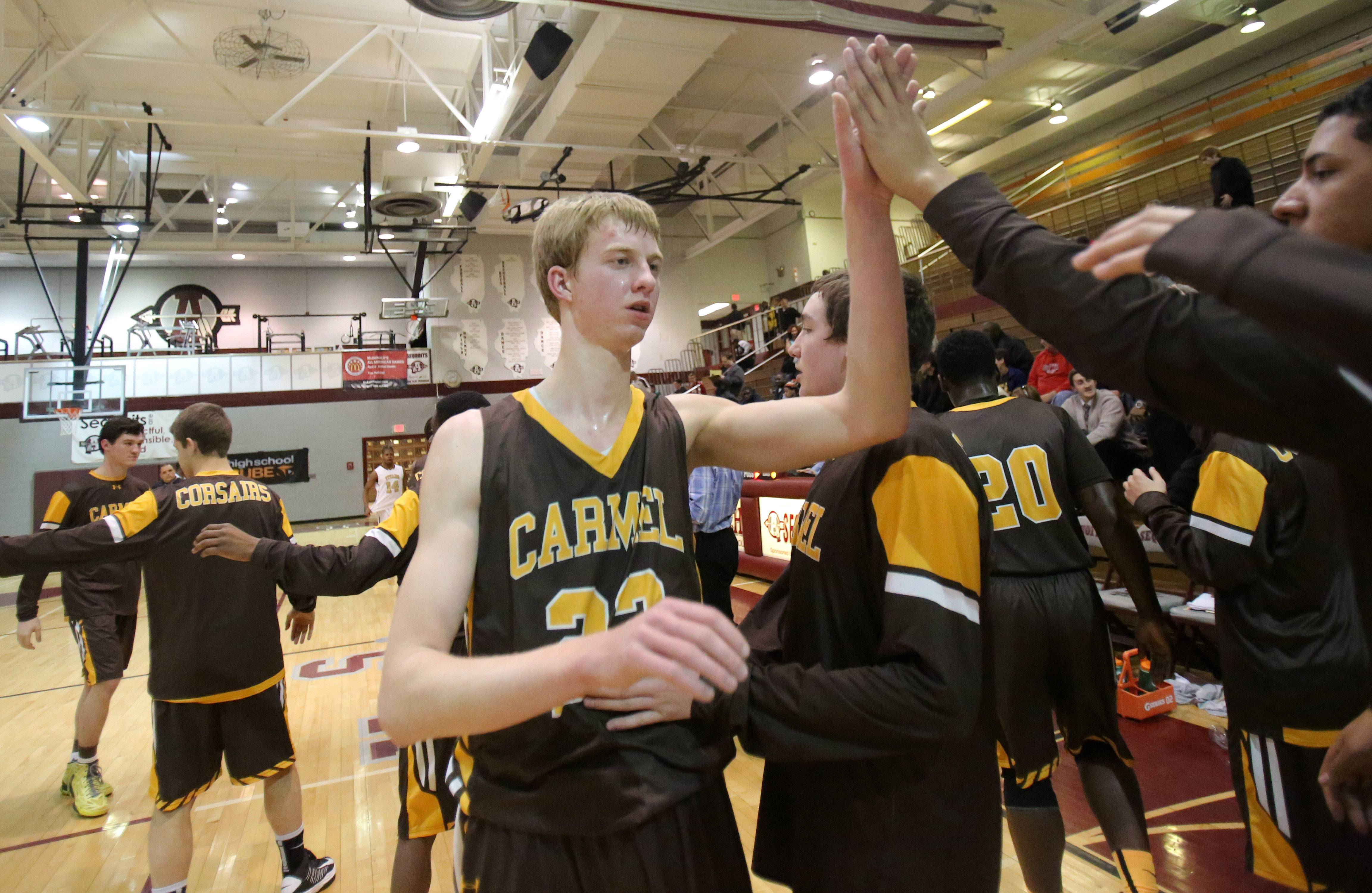 Carmel's Michael Barr celebrates after the Corsairs' win over Uplift in the Class 3A sectional semifinal at Antioch.