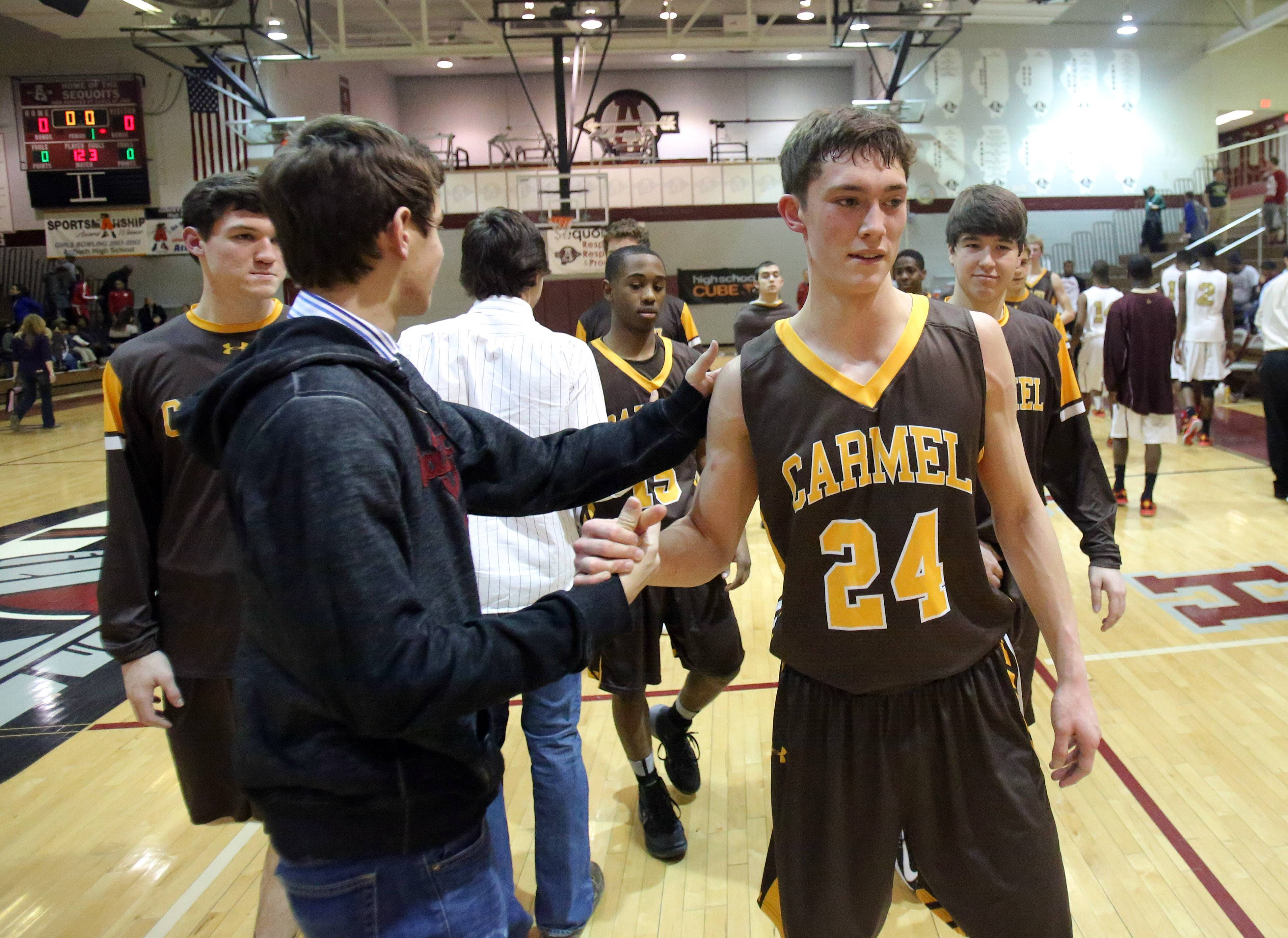 Carmel's Billy Kirby celebrates after the Corsairs' win over Uplift in the Class 3A sectional semifinal at Antioch on Wednesday.