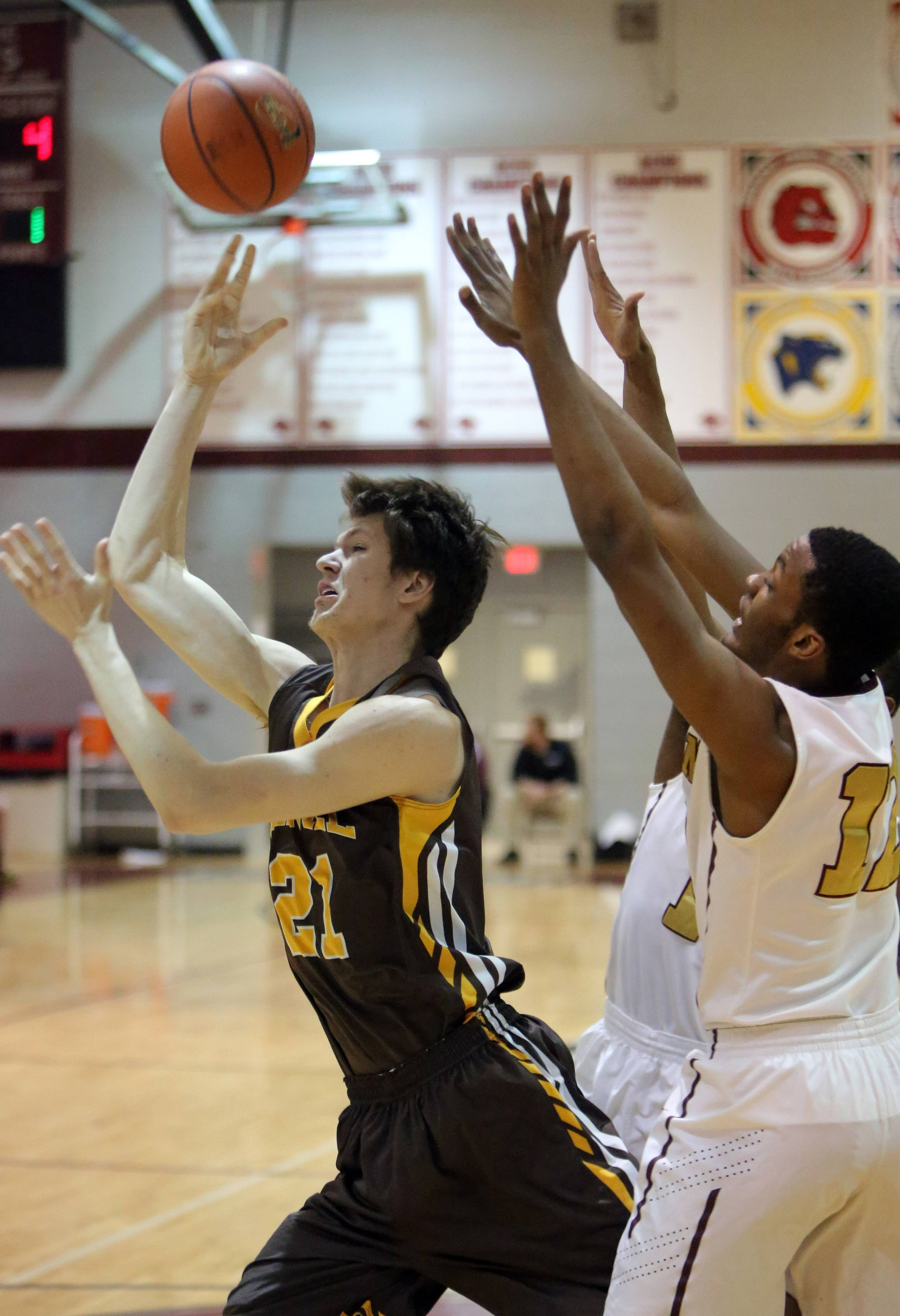 Carmel's Jack George, left, drives on Uplift's Jamaya Wyatt.