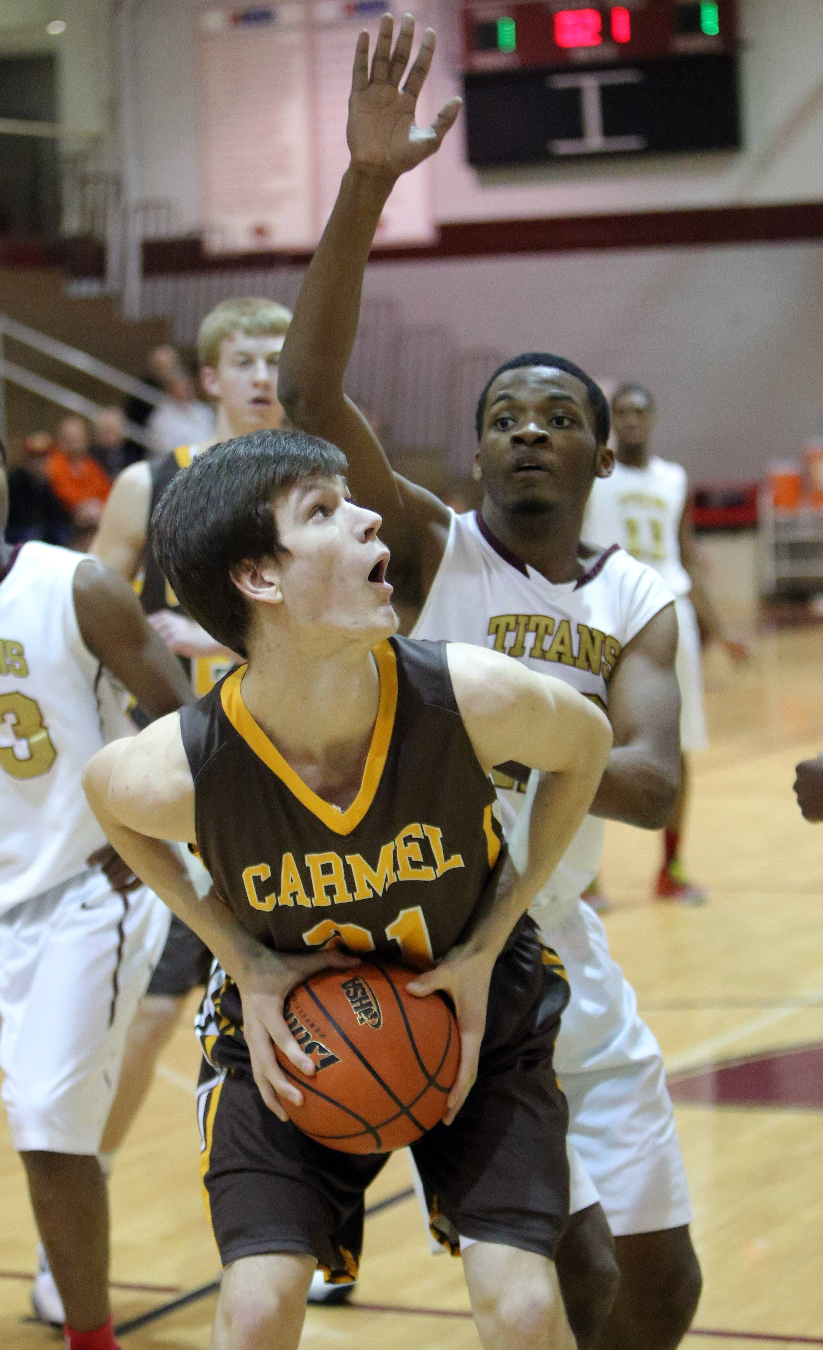 Carmel's Jack George, left, looks to shoot on Uplift's Jamaya Wyatt .