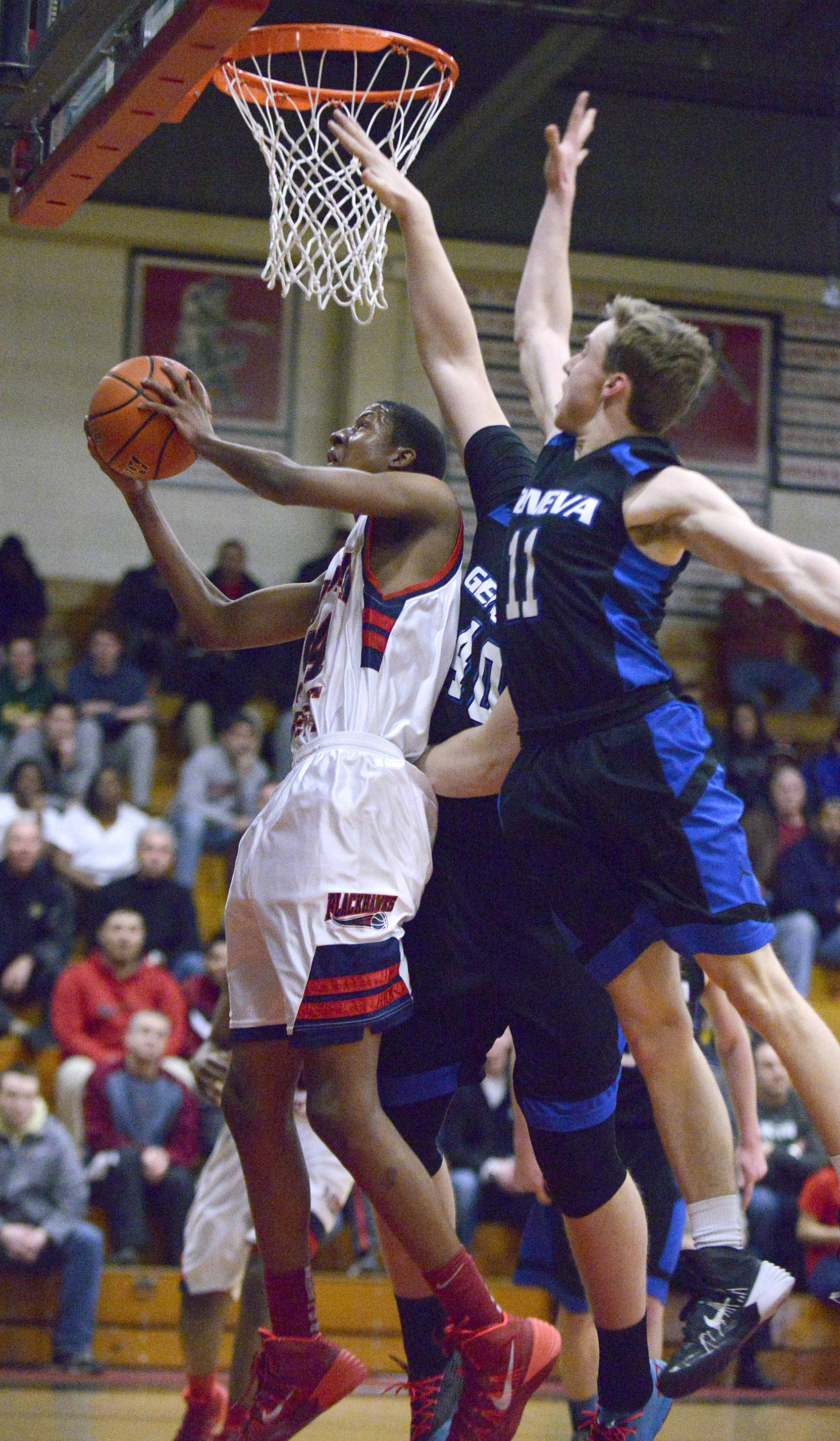 West Aurora's Carleton Williams is swarmed by Geneva's Cameron Cook and Loudon Vollbrecht in the second quarter.