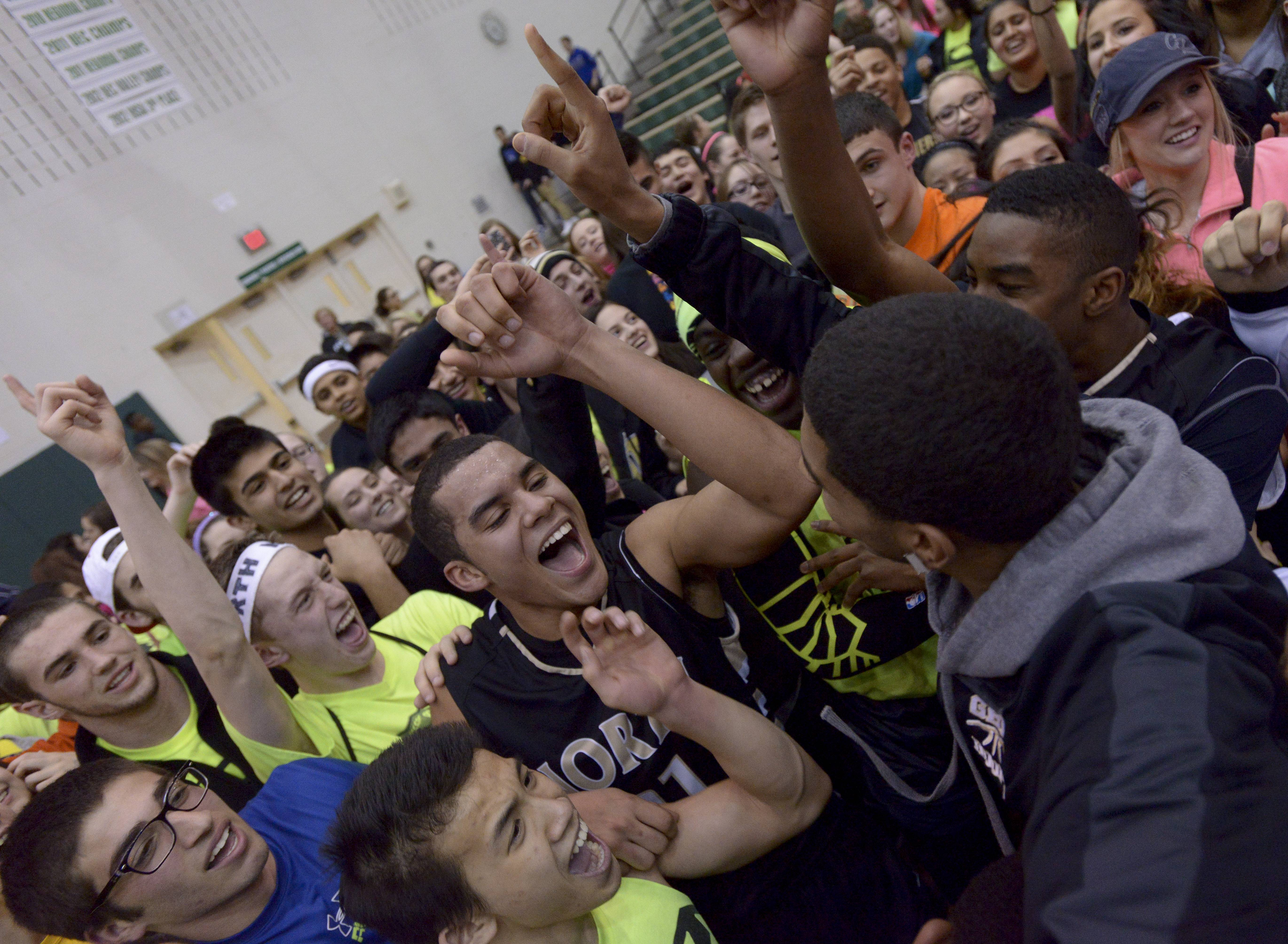 Glenbard North's Kendall Holbert, center, celebrates with his teammates and fans.