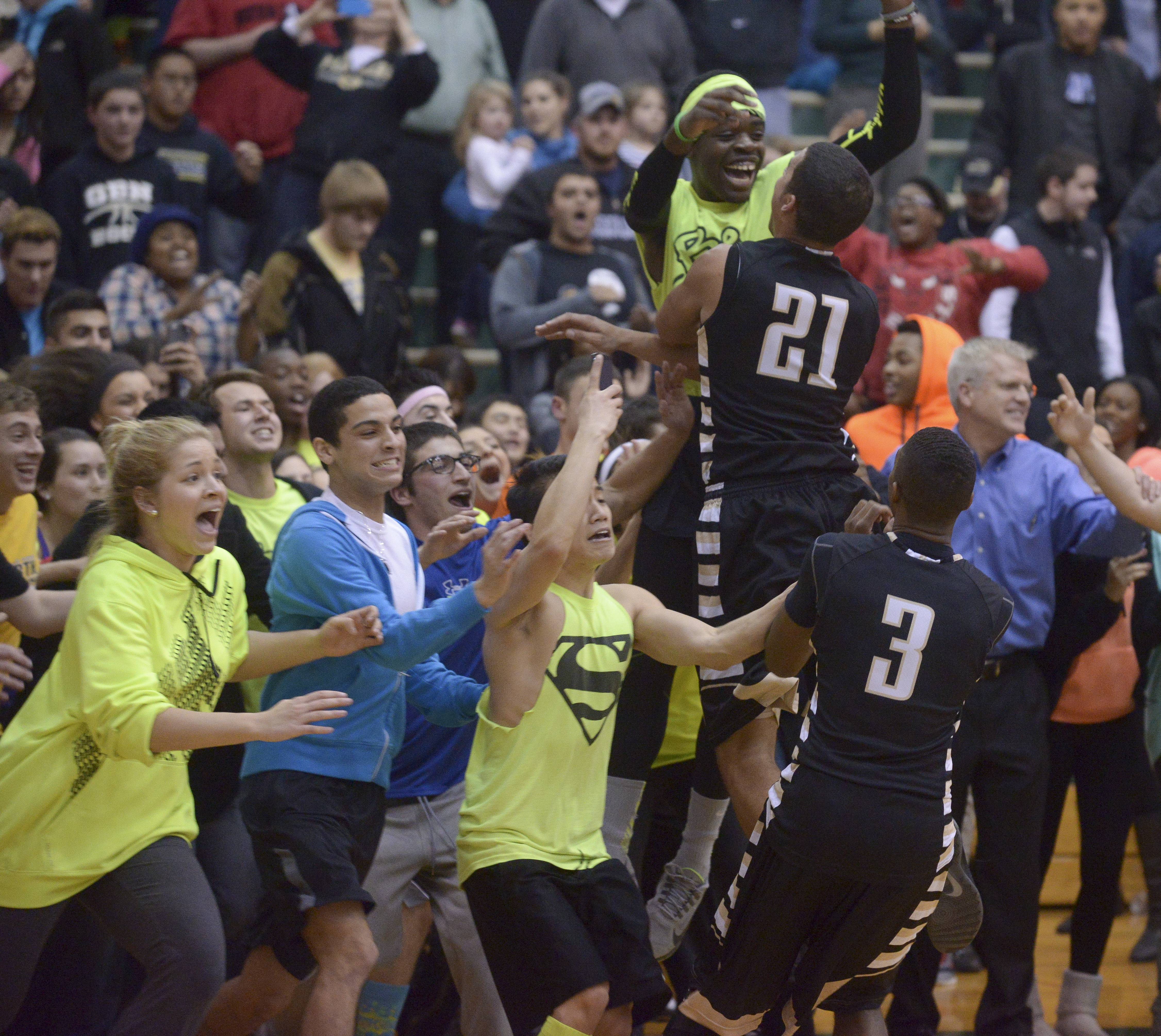 Glenbard North's Kendall Holbert celebrates with his teammates.