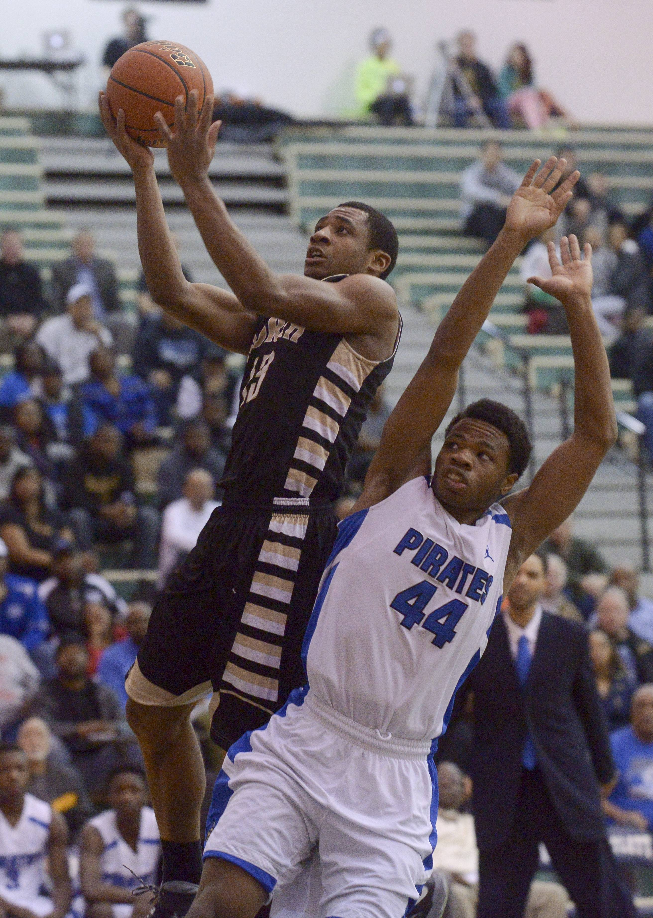 Glenbard North's Justin Jackson gets past Proviso East's Josh Smith.