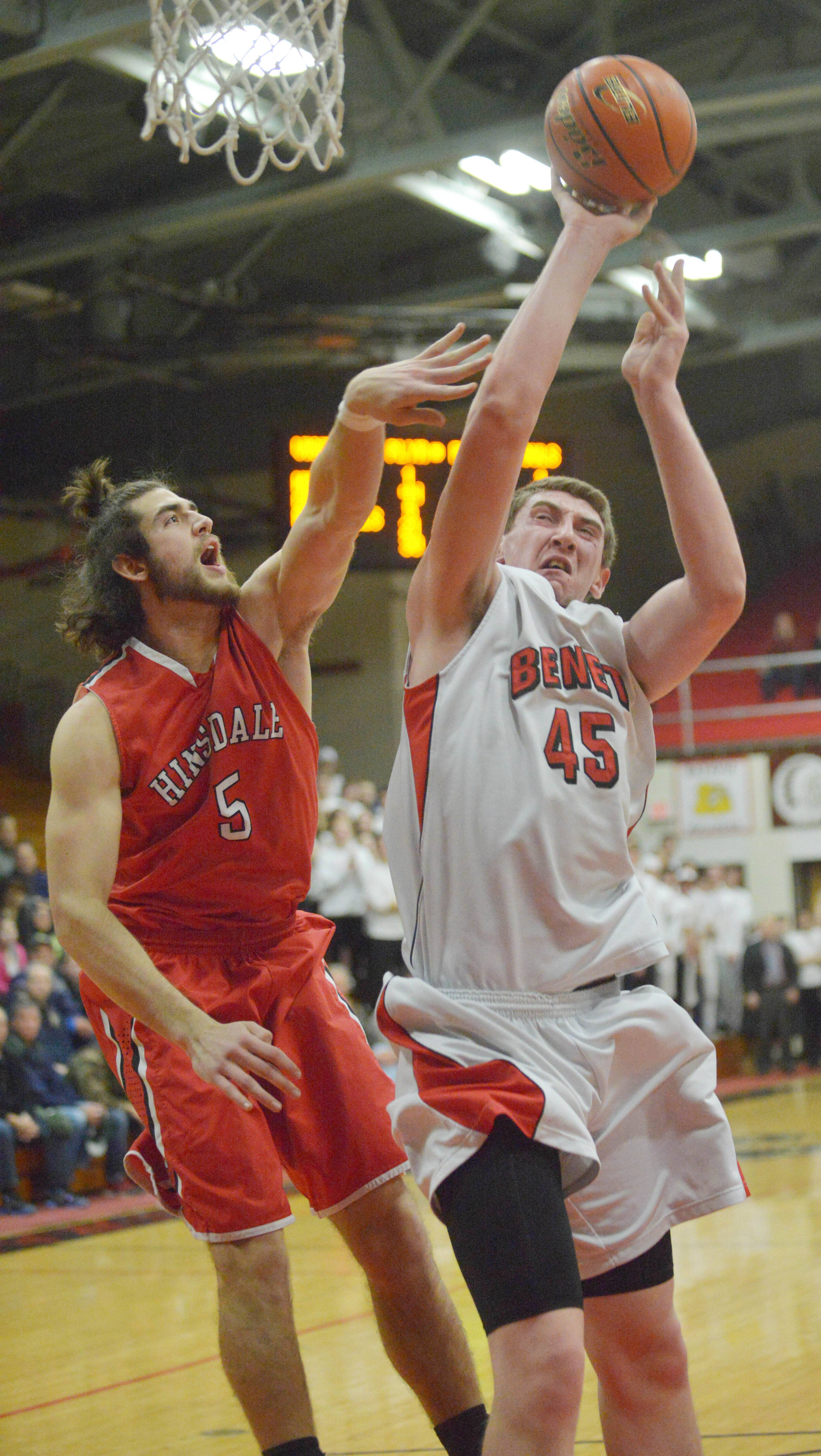 (5) Ian bunting of Hinsdale Central and (45) Sean O'Mara of Benet work the net during the Benet vs. Hinsdale Central at Class 4A East Aurora boys basketball sectional semifinal Tuesday.