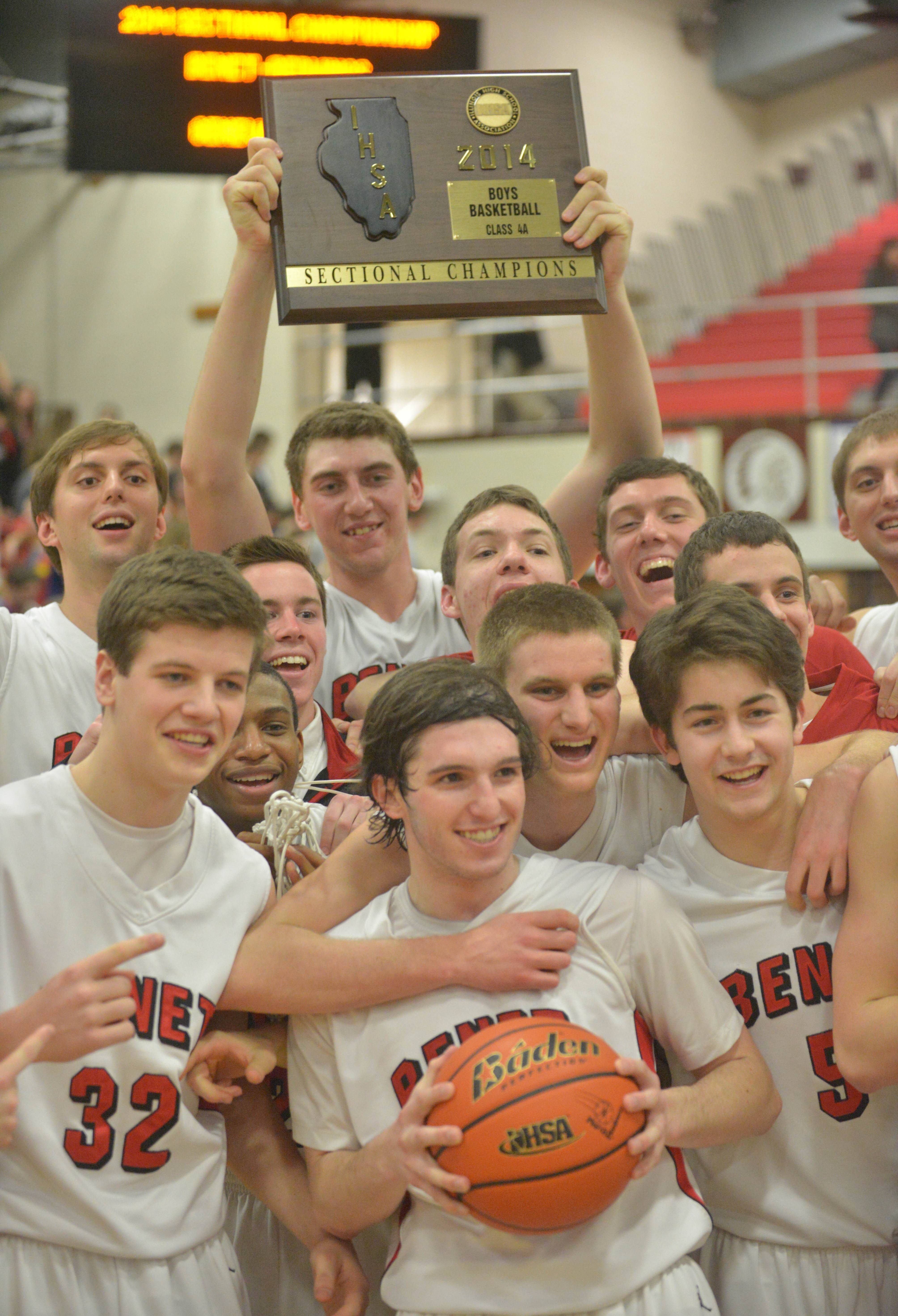 Benet celebrates their big win after the Benet vs. Geneva Class 4A East Aurora boys basketball sectional final Friday.