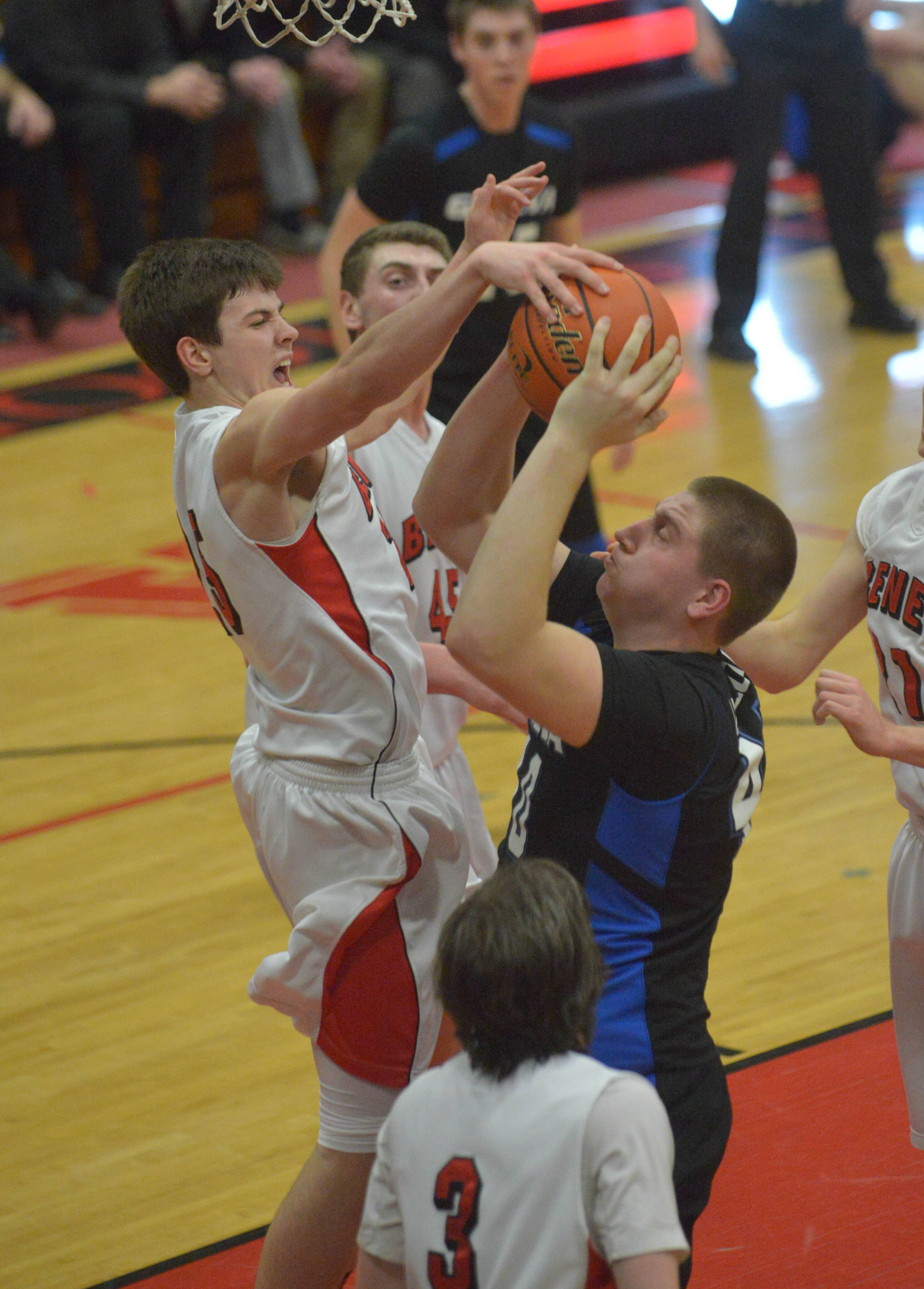 (25) Liam Nelligan of Benet blocks shot from (40) Loudon Vollbrecht of Geneva during the Benet vs. Geneva Class 4A East Aurora boys basketball sectional final Friday.