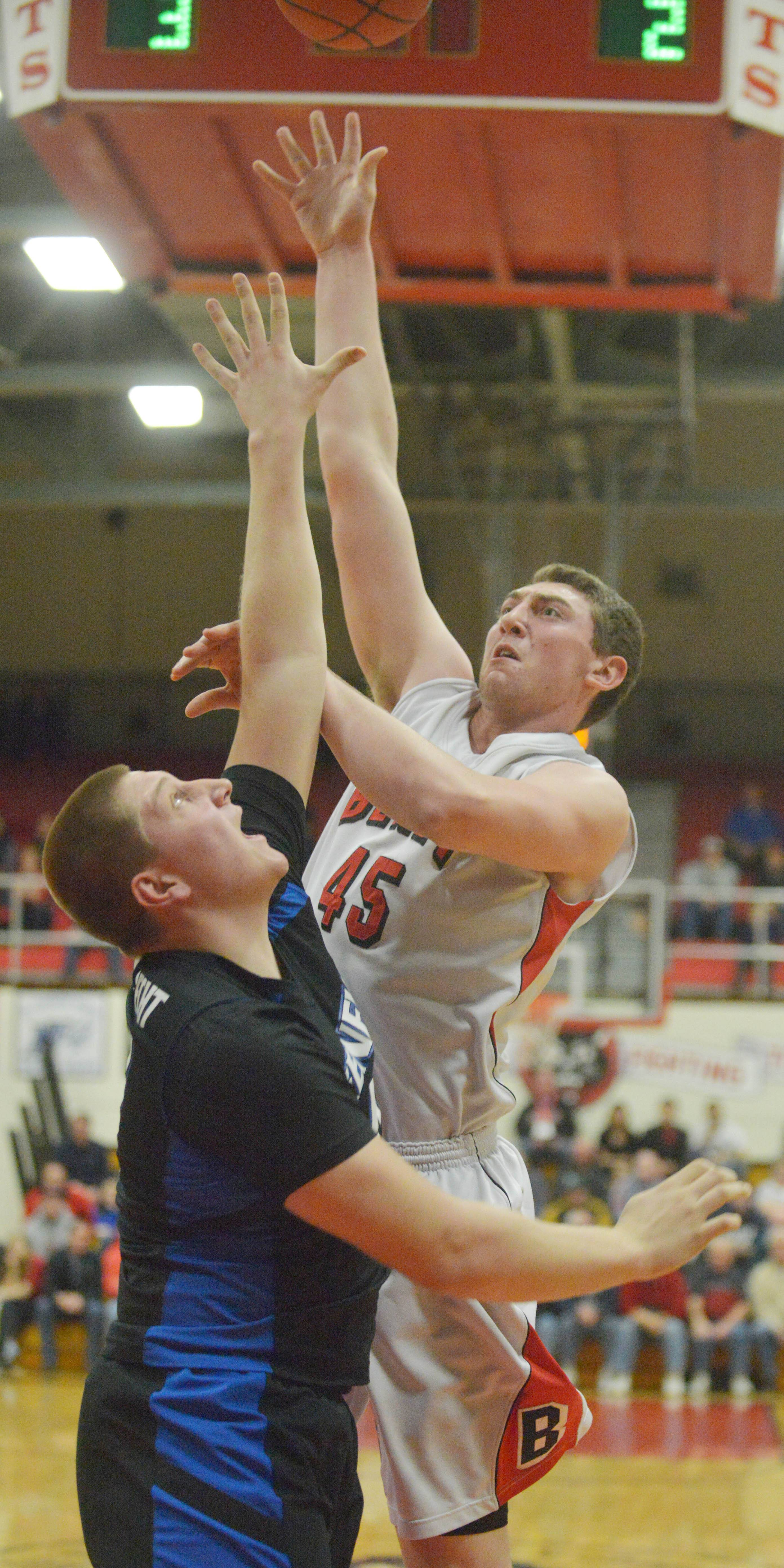 (40) Loudon Vollbrecht of Geneva attempts to block a shot form Sean O'Mara of Benet during the Benet vs. Geneva Class 4A East Aurora boys basketball sectional final Friday.