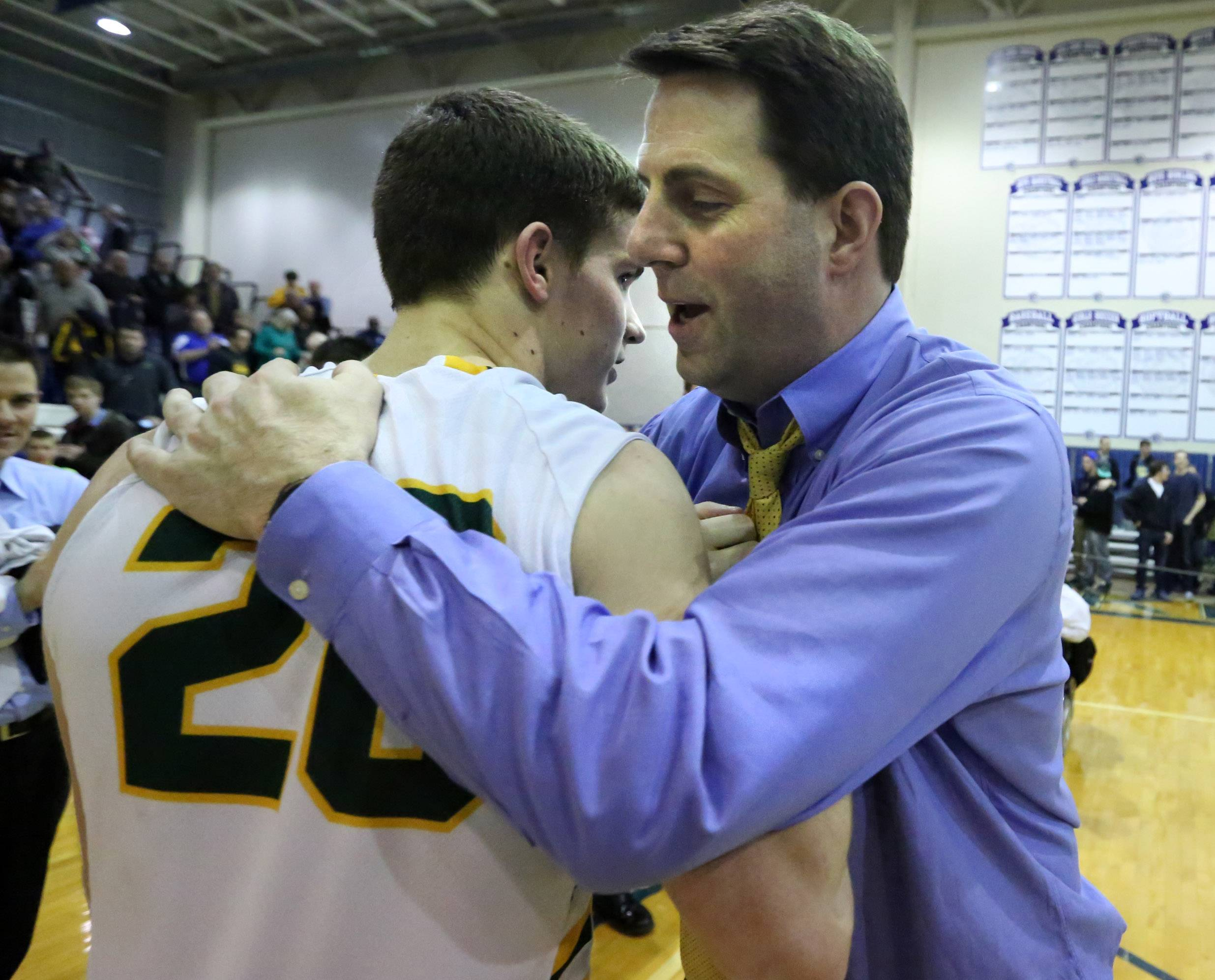 Stevenson coach Pat Ambrose hugs Matt Morrissey at Lake Zurich after Stevenson won the Class 4A sectional final on Friday in Lake Zurich.