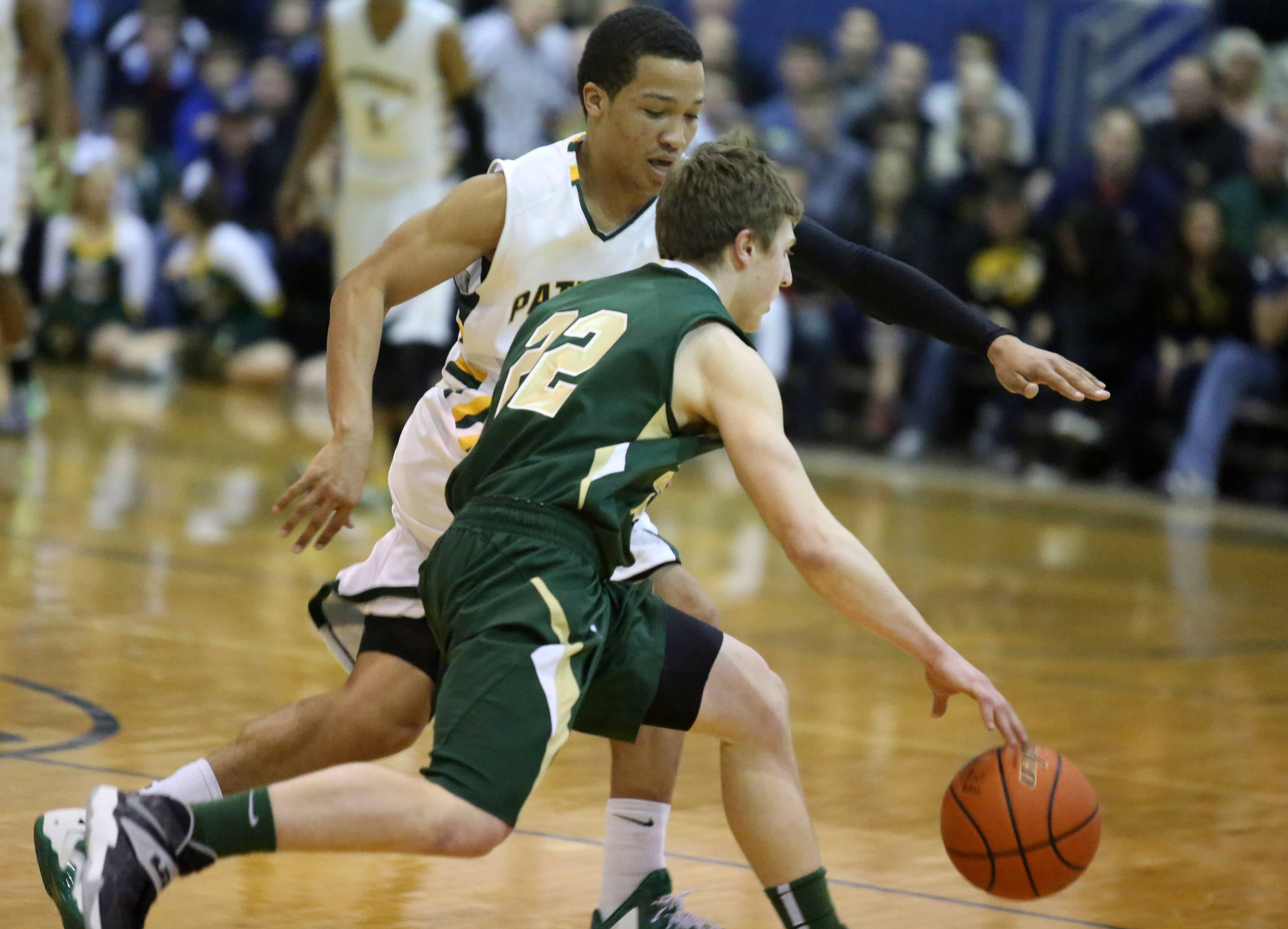 Fremd guard Garrett Groot pushes the ball upcourt against Stevenson defender Jalen Brunson during Stevenson's victory in the Lake Zurich sectional final.