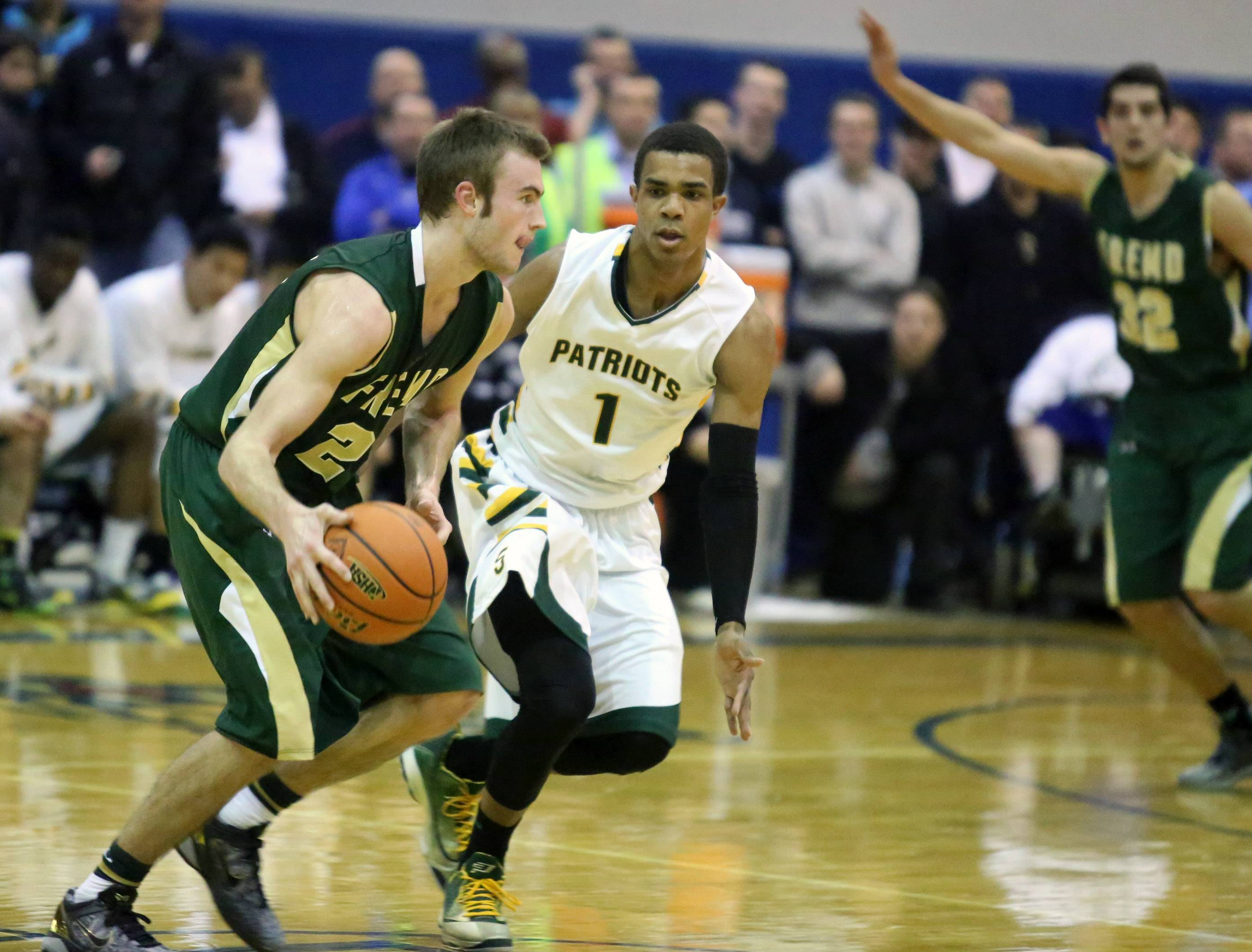 Fremd guard Riley Glassmann bringsthe ball upcourt against Stevenson defender Connor Cashaw during the Patriots' vctory in the Lake Zurich sectional final