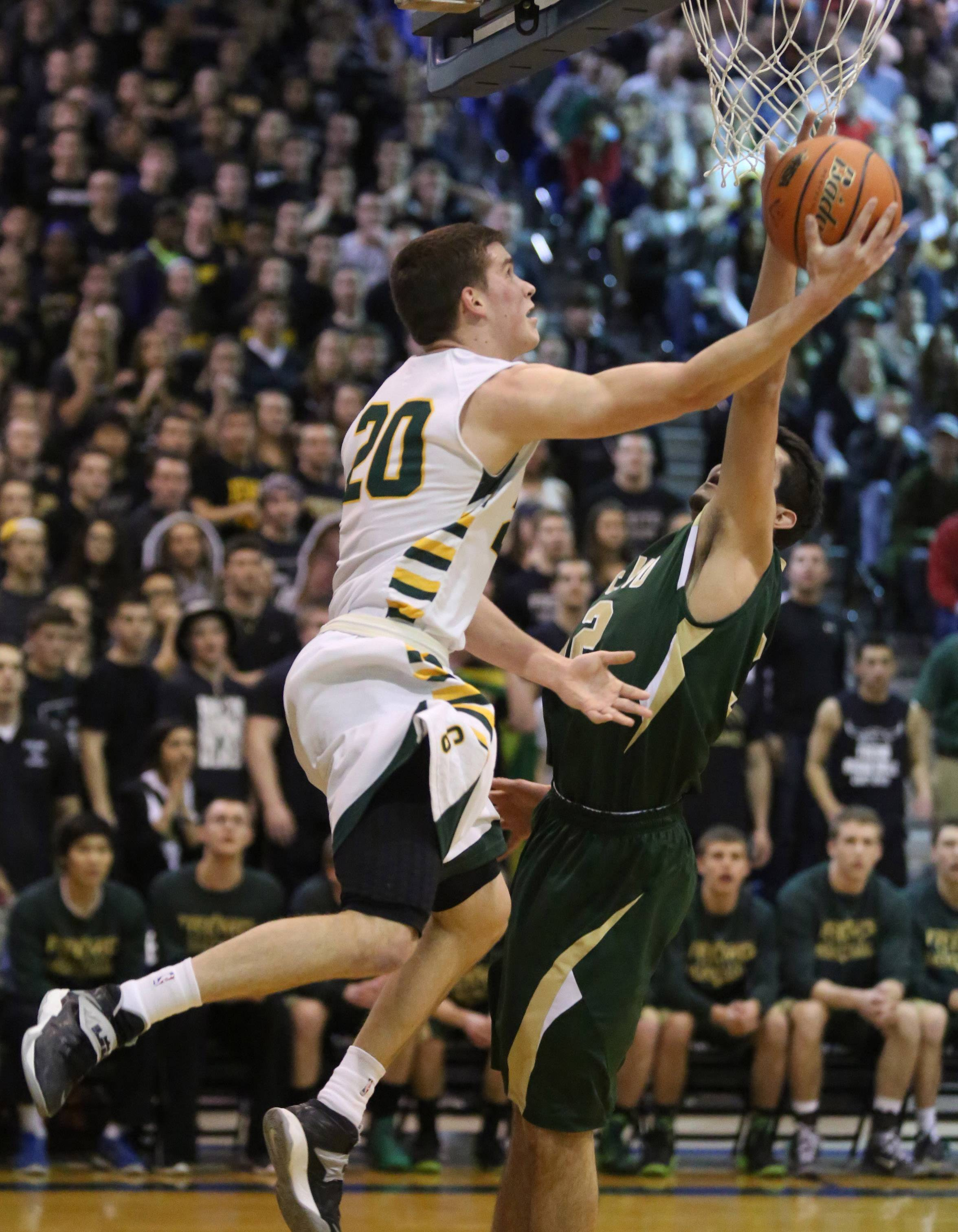 Stevenson guard Matt Morrissey lays the ball up under the basket against Fremd as Stevenson wins the Class 4A sectional final over Fremd on Friday in Lake Zurich.
