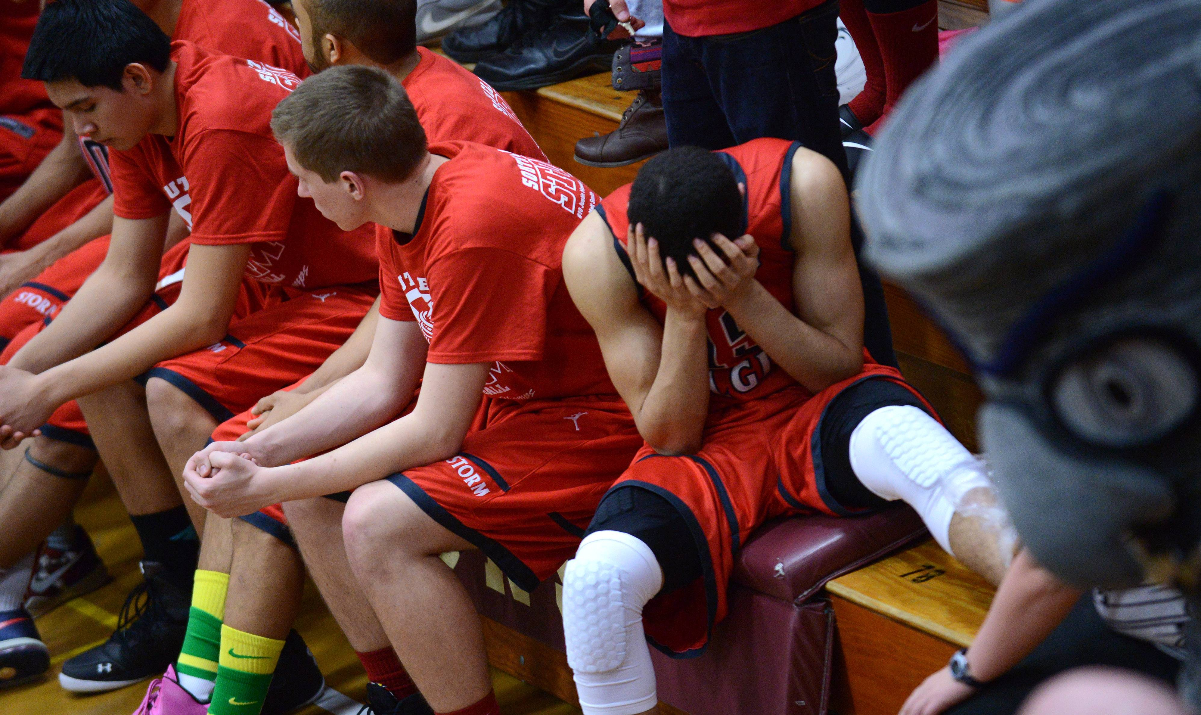 The South Elgin bench, including an injured Matthew Smith (15) waits out the final seconds of Friday's Class 4A Elgin sectional final loss to Rockford Auburn.