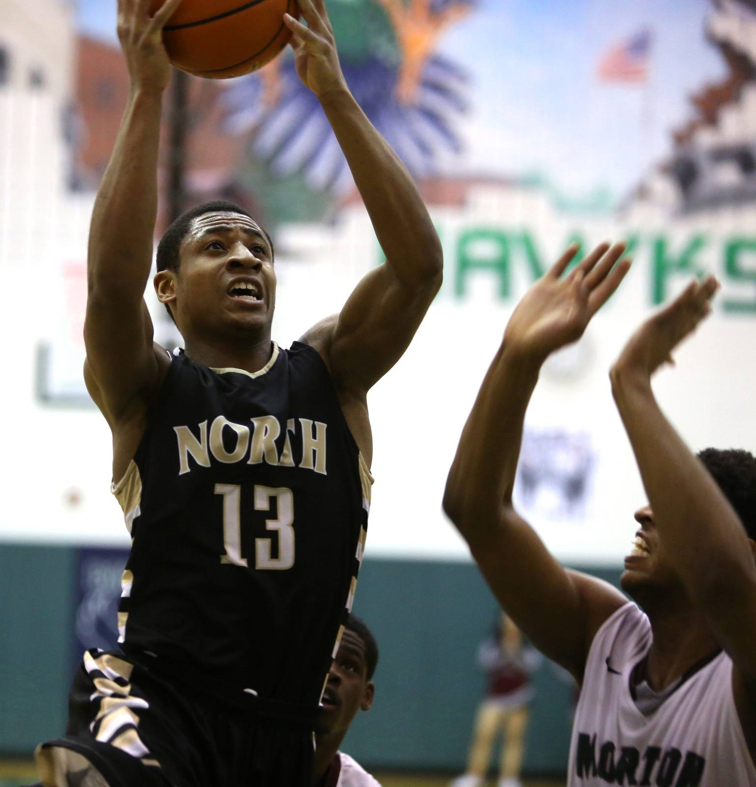 Glenbard North's Justin Jackson drives to the basket.
