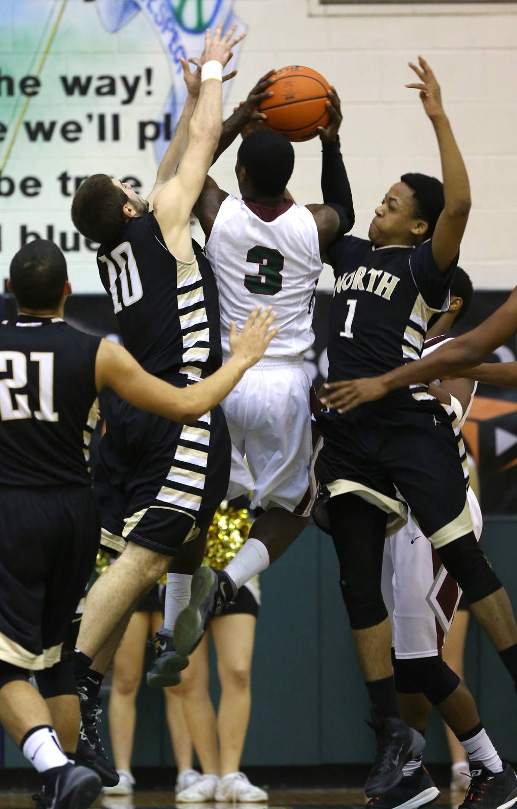 Glenbard North's Pasquale Fiduccia and Jeremiah Fleming  apply defensive pressure on  Morton's Jarvis Cannon.