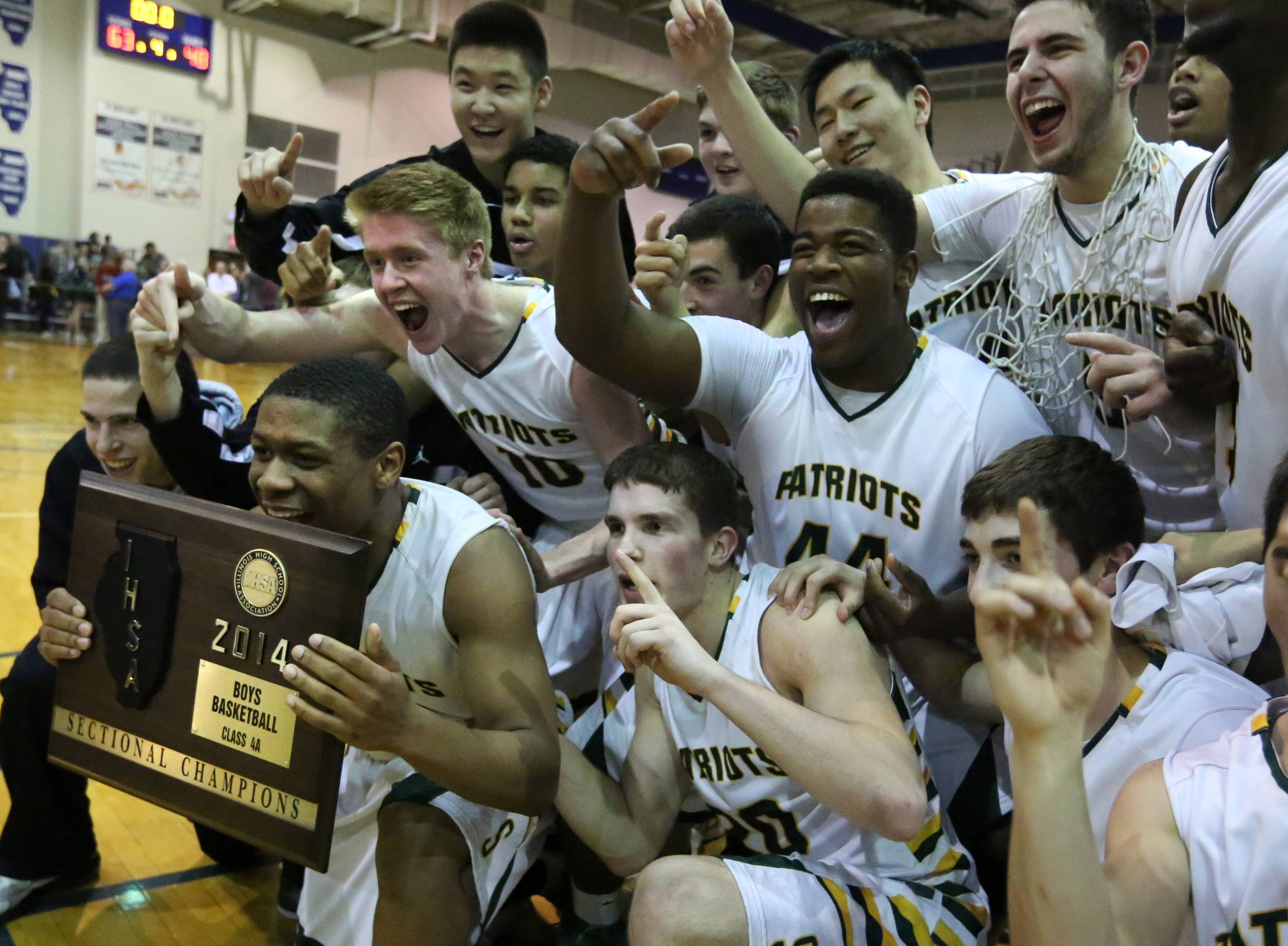 Stevenson's Matt Johnson, holding plaque, and teammates celebrate.
