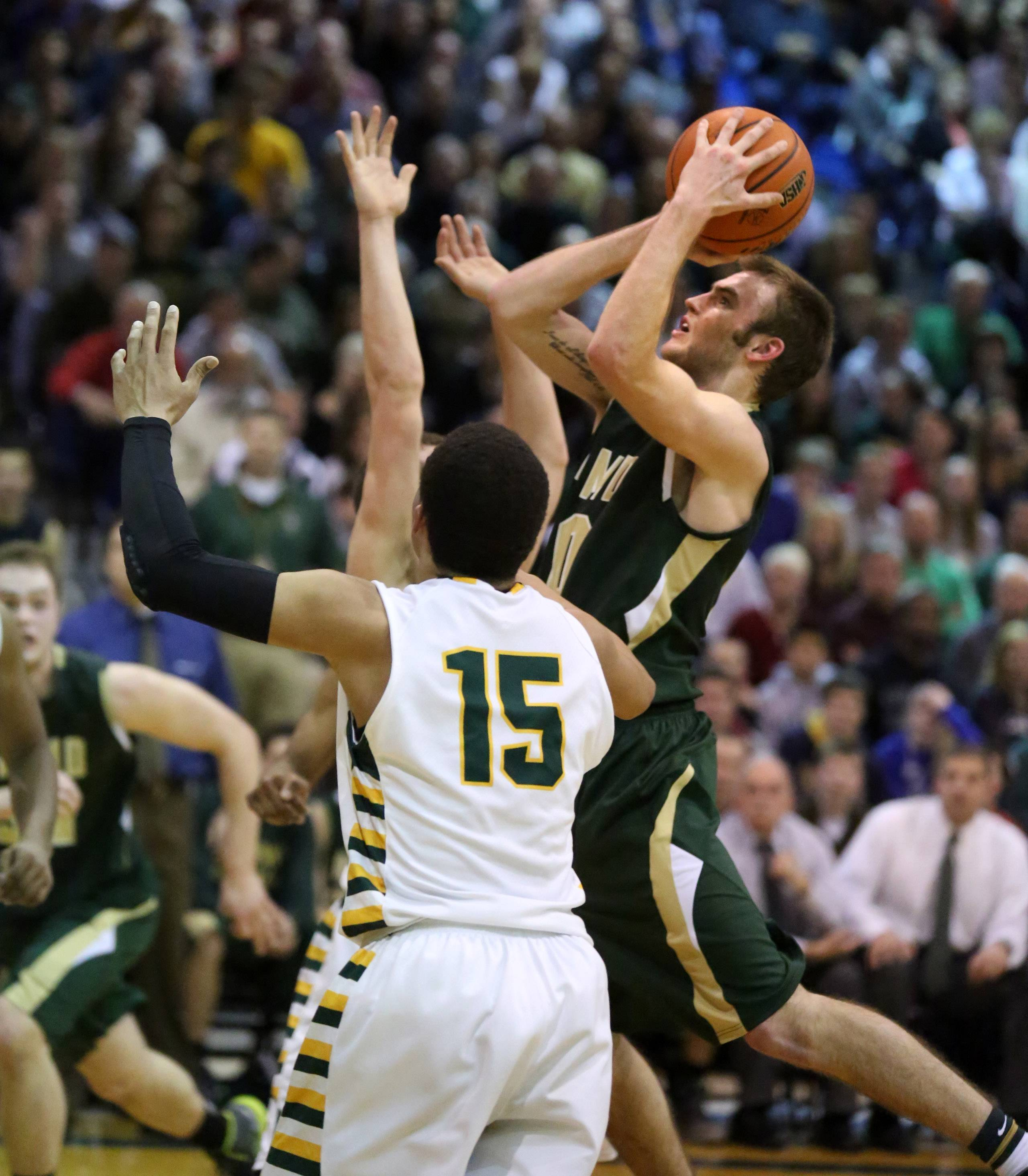 Fremd guard Raymond Riley Glassmann shoots over Stevenson defender Jalen Brunson.