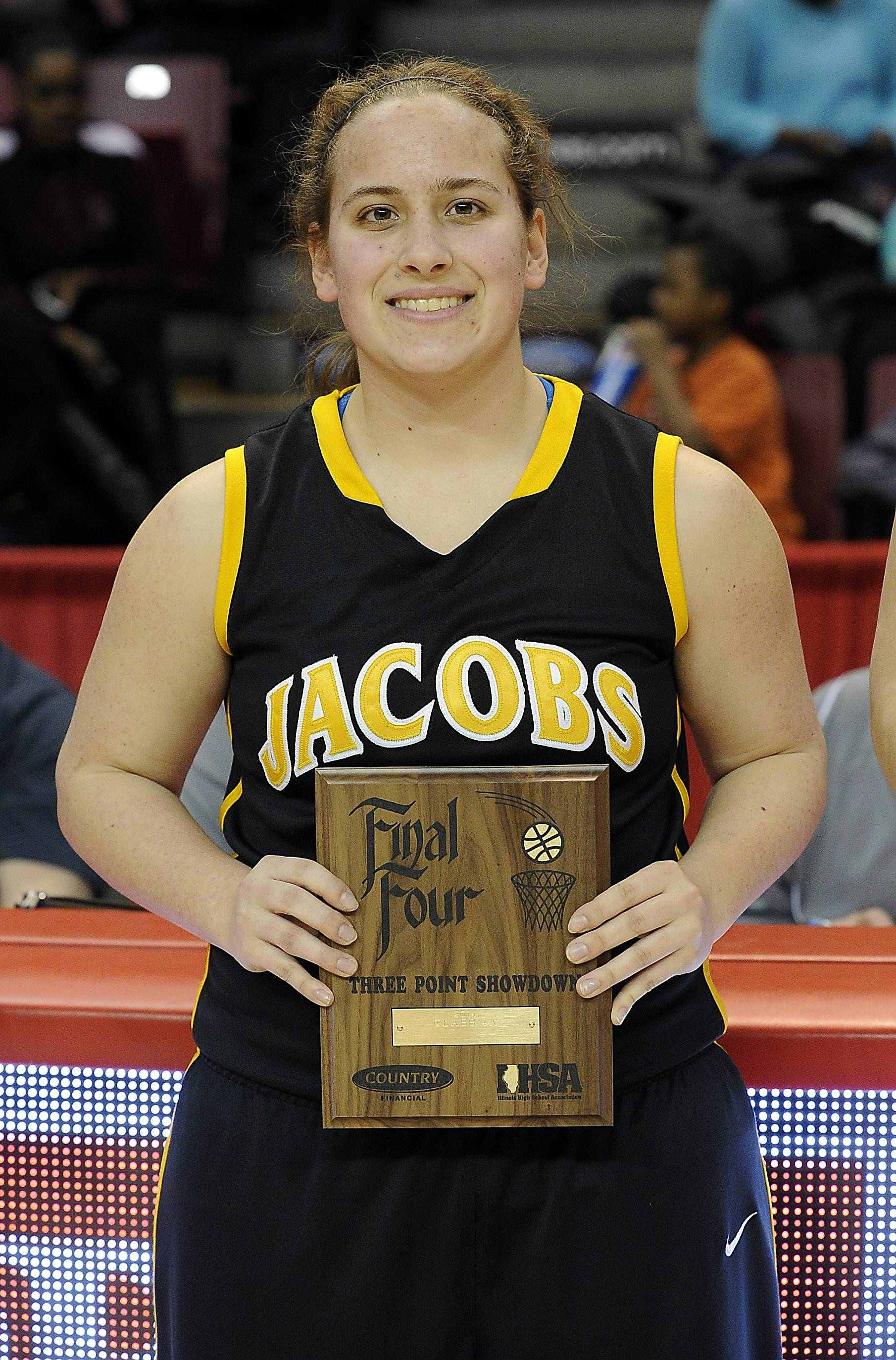 Alyssa Lach of Jacobs is all smiles after reaching the Class 4A Final Four in the IHSA's 3-point contest at Redbird Arena in Normal last weekend.