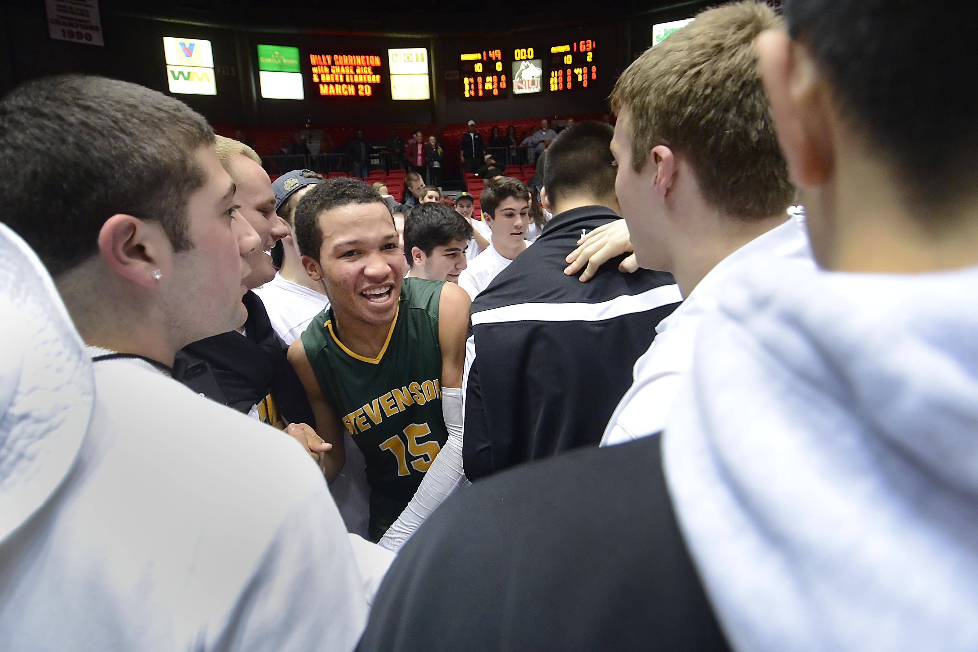 Stevenson's Jalen Brunson is surrounded by classmates after the Patriots defeated Rockford Auburn in the Class 4A Northern Illinois University supersectional Tuesday.