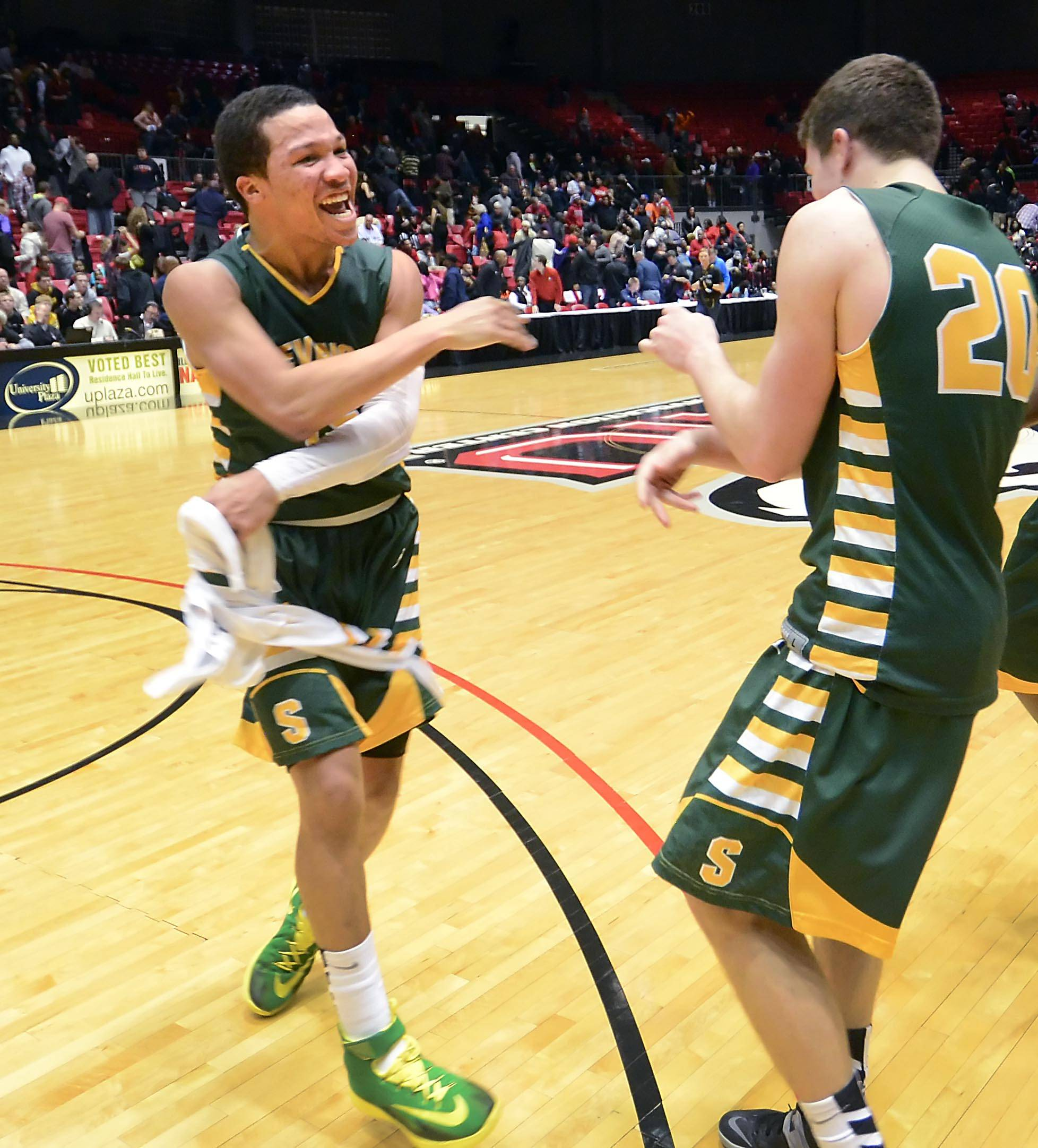 Stevenson's Jalen Brunson and Matt Morrissey, right, celebrate their win over Rockford Auburn in the Class 4A Northern Illinois University supersectional Tuesday.