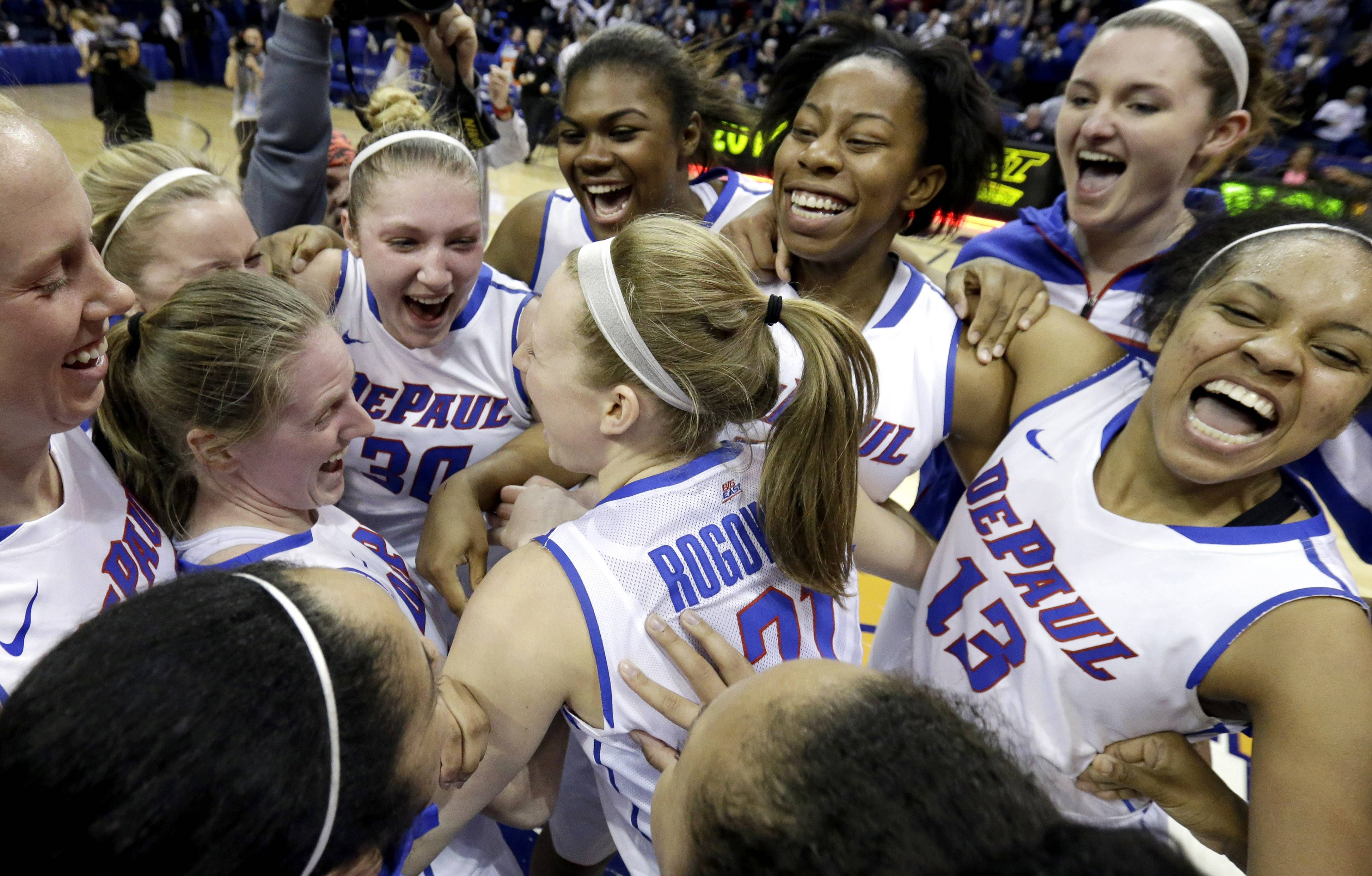 DePaul players celebrate after defeating St. John's last week in the final of the Big East women's tournament at the Allstate Arena. DePaul will face Oklahoma on Saturday in the first round of the NCAA Tournament.