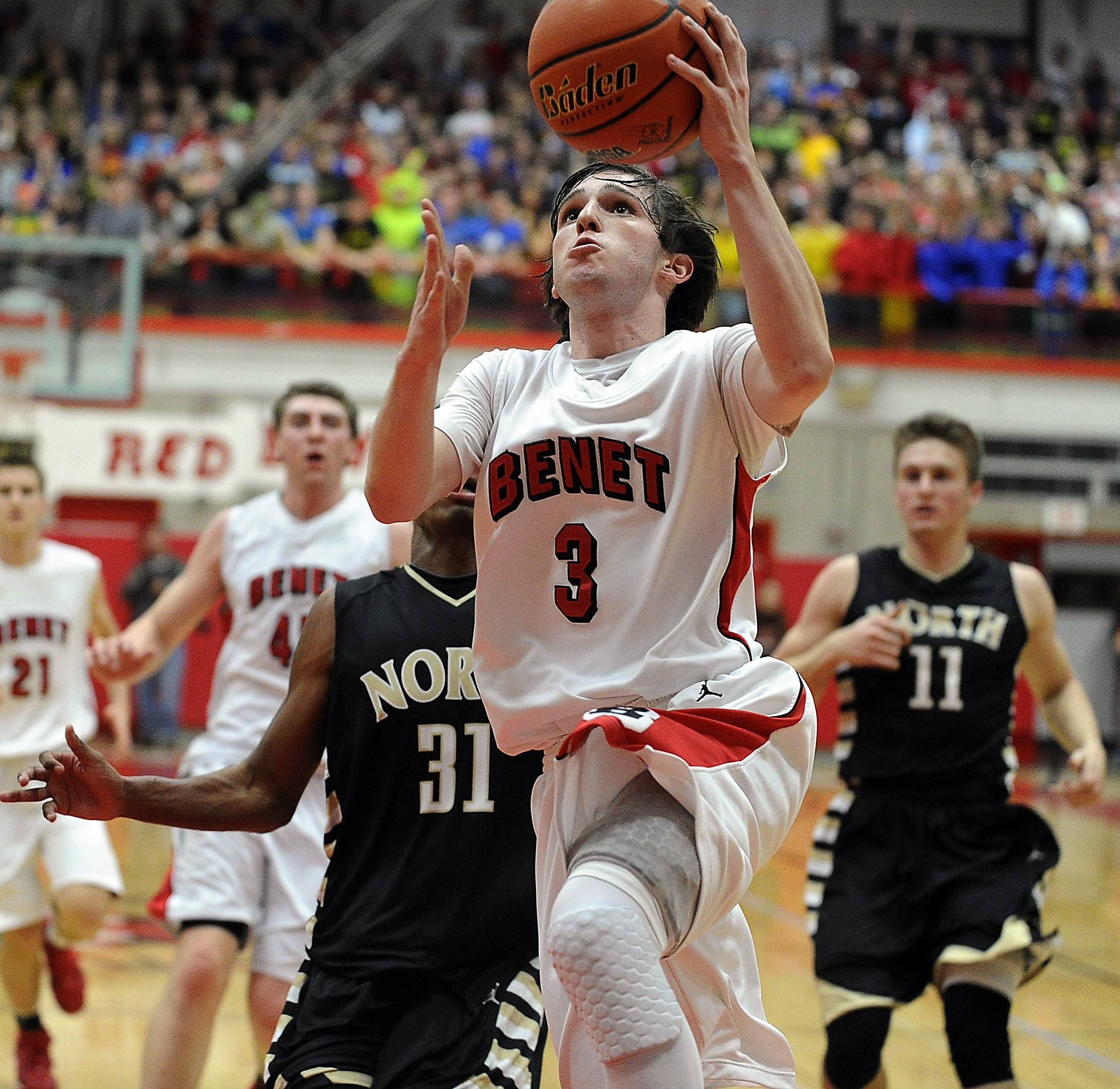 Benet's Collin Pellettieri delivers the points on a steal from Glenbard North defense in the first half in the supersectional boys basketball at Hinsdale Central on Tuesday.