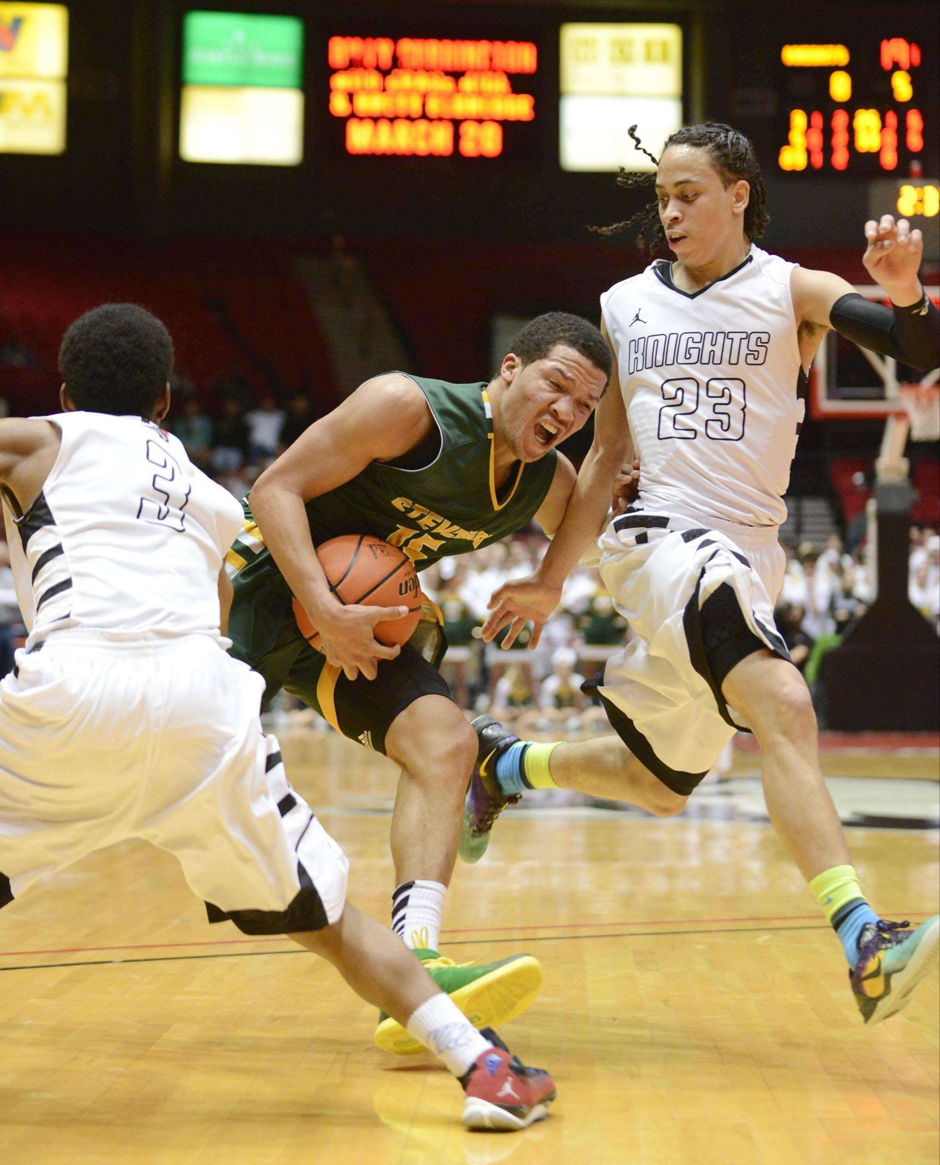 Stevenson guard Jalen Brunson heads to the basket during Tuesday's supersectional at NIU.