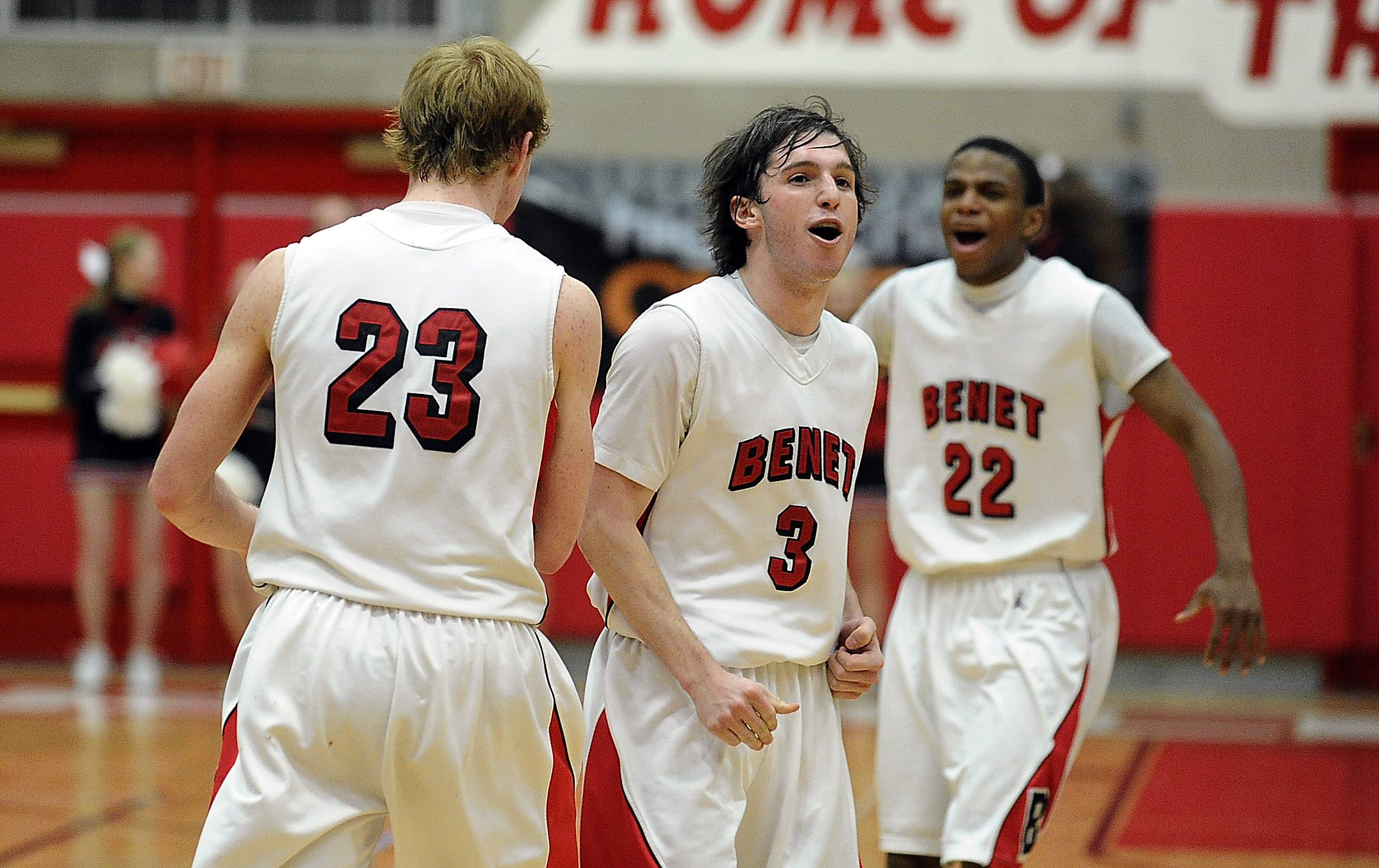 Benet's Colin Bonnett, Collin Pellettieri and Josh Yesufu begin the celebration at the end of Tuesday's supersectional victory at Hinsdale Central.